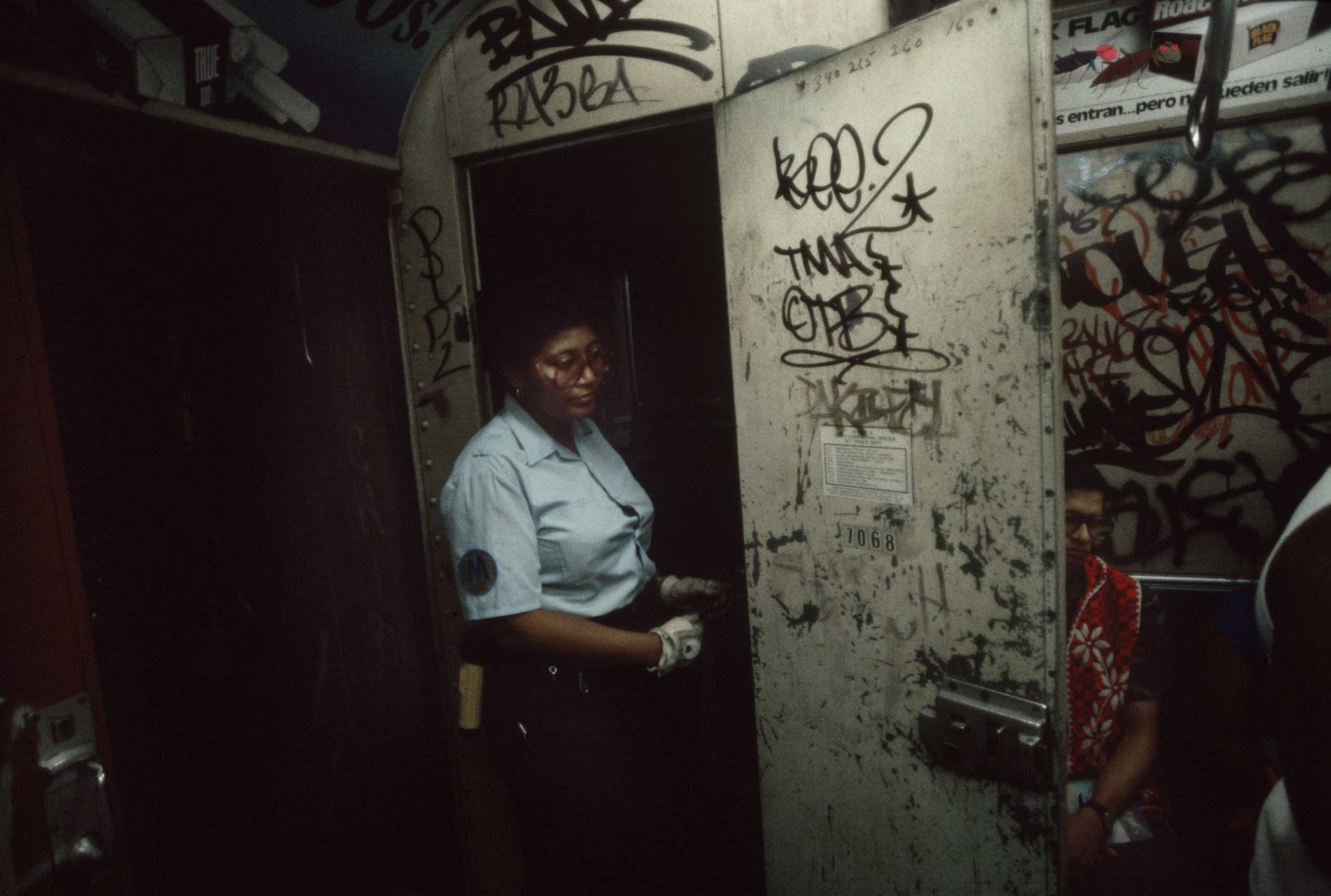 A subway conductor exits the conductor's cabin, 1981.