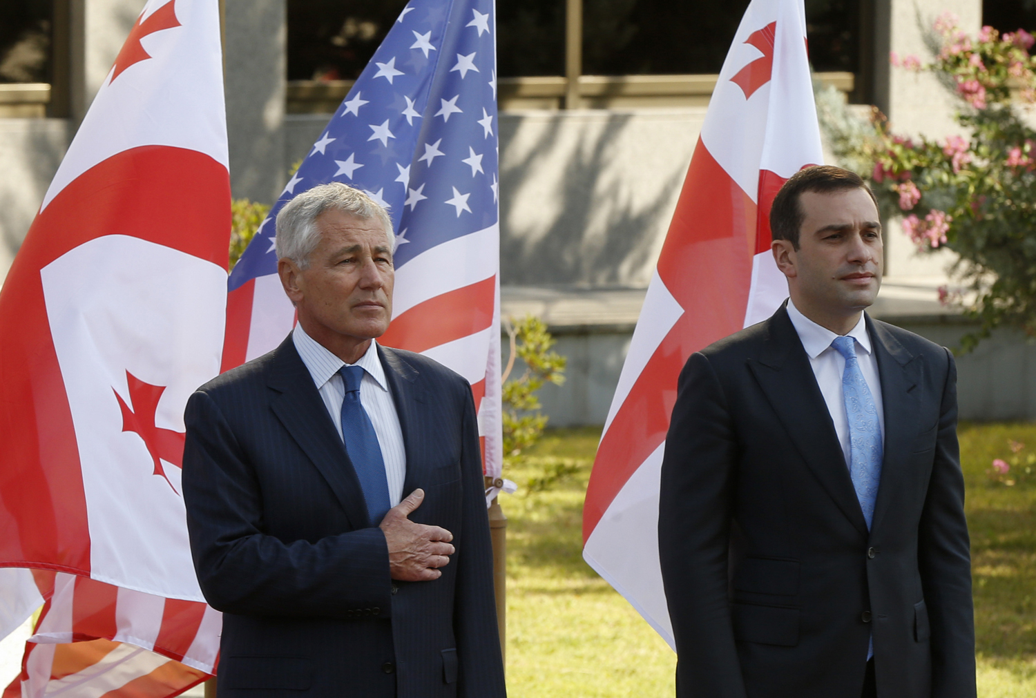 Georgia's Defence Minister Irakly Alasania (R) and U.S. Defense Secretary Chuck Hagel attend an official welcoming ceremony in Tbilisi on September 7, 2014.