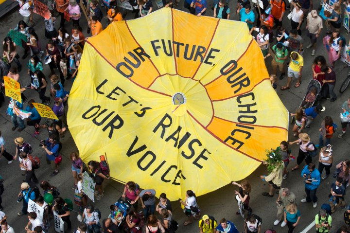 Some of hundreds of thousands take part in the People's Climate March through Midtown, New York