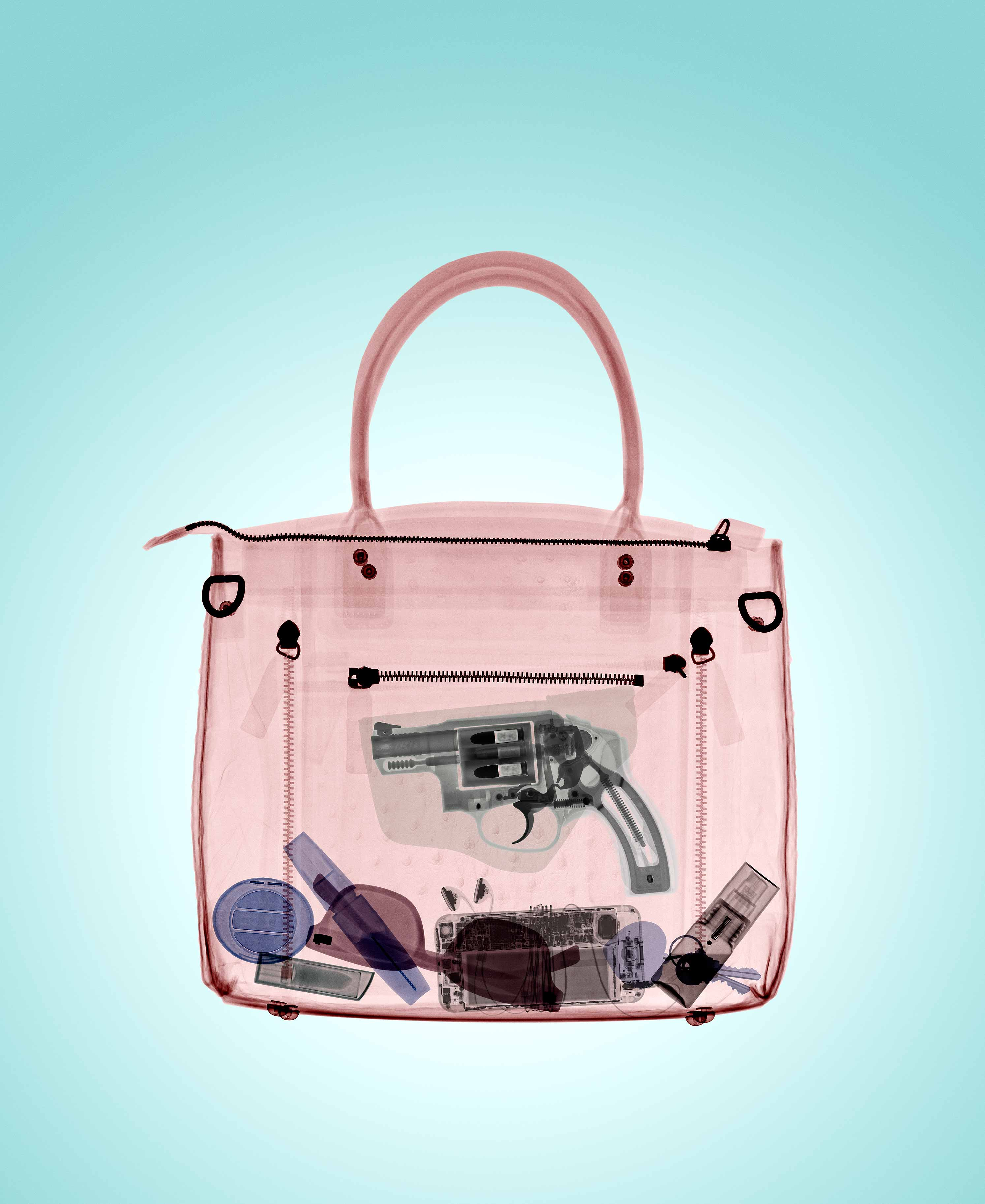 Companies are courting the growing ranks of women carrying concealed weapons with products like this handbag with a hidden gun pouch