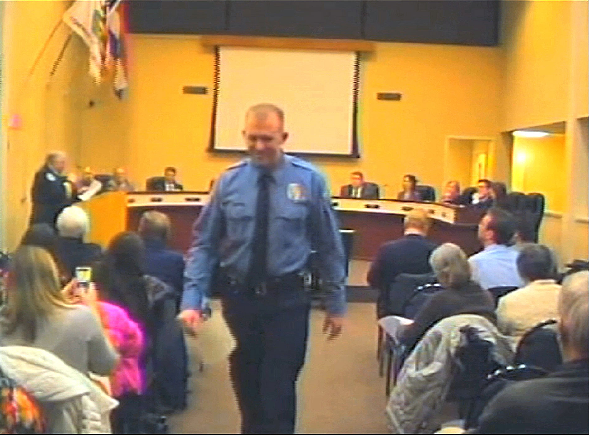 Officer Darren Wilson, seen in a video provided by the City of Ferguson, attends a city council meeting in Ferguson, Mo.
