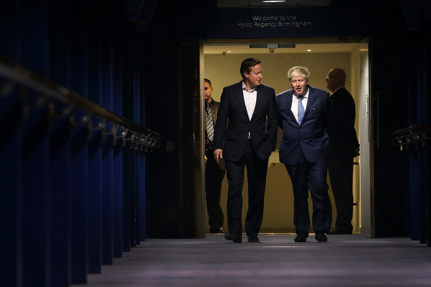 Prime Minister David Cameron walks with Mayor of London and Parliamentary candidate Boris Johnson at the Conservative party conference on Sept. 29, 2014 in Birmingham, England.