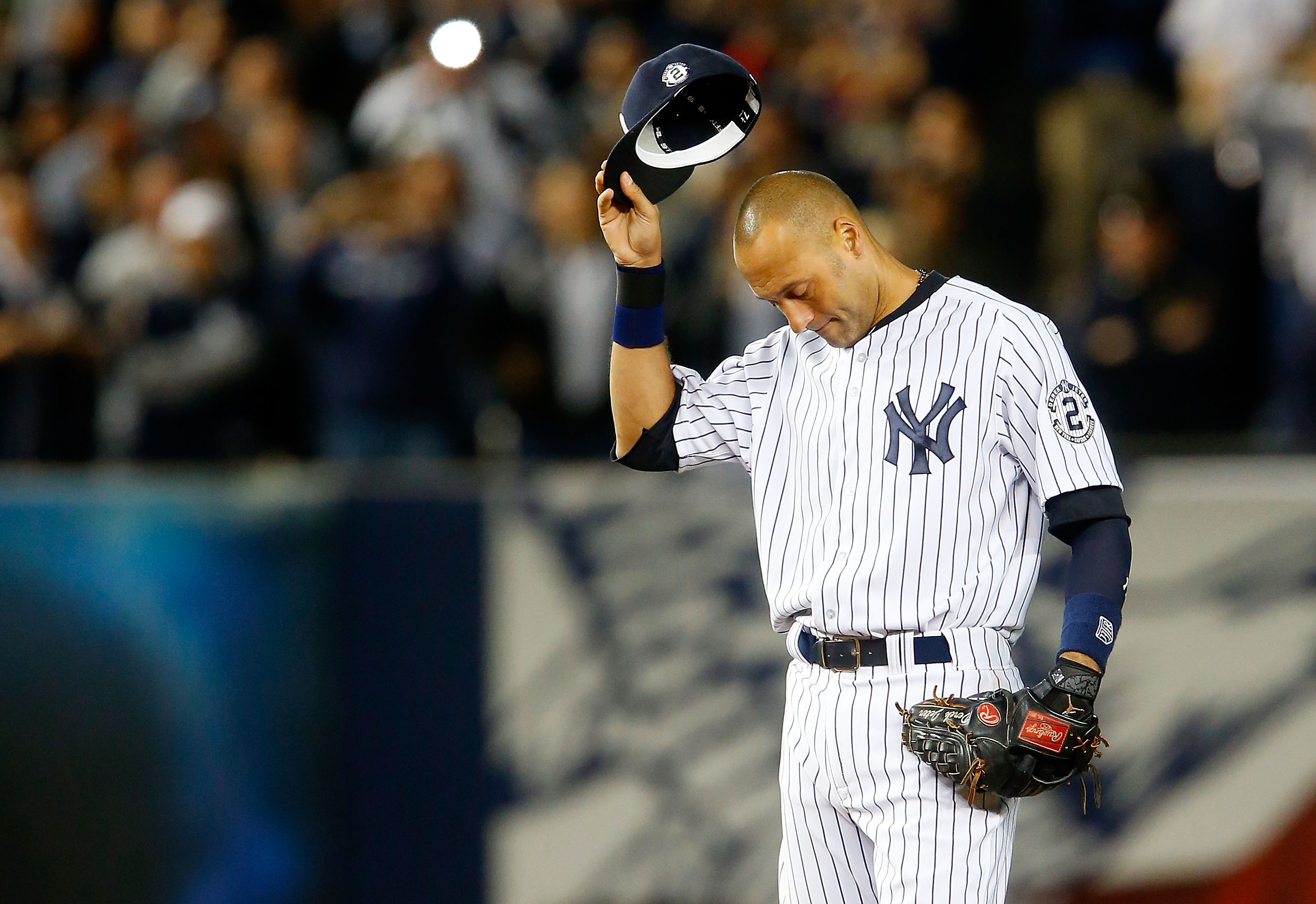 Derek Jeter #2 of the New York Yankees gestures to the crowd during a game against the Baltimore Orioles at Yankee Stadium on September 25, 2014 in the Bronx borough of New York City. The game was Jeter's last at Yankee Stadium and the Yankees defeated the Orioles 6-5.