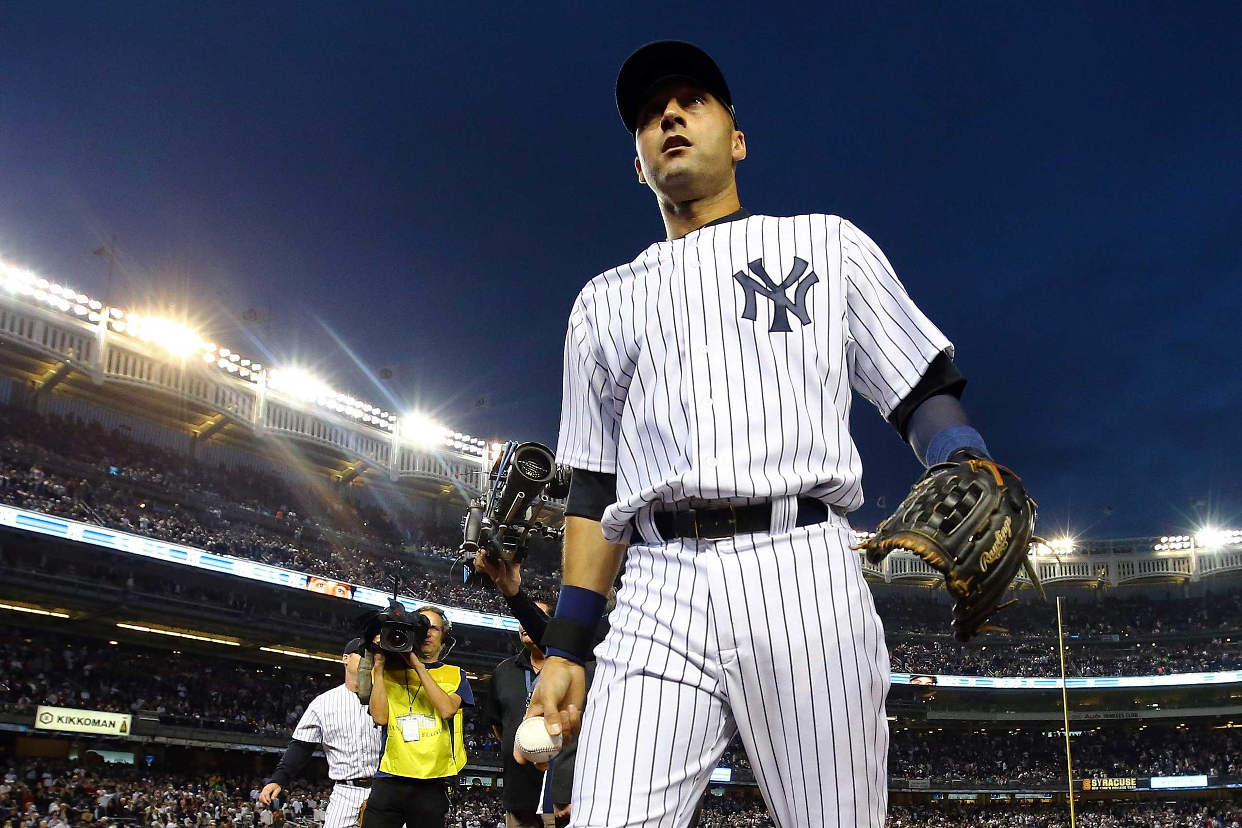 Derek Jeter of the New York Yankees walks into the dugout against the Baltimore Orioles at Yankee Stadium on Sept. 25, 2014.