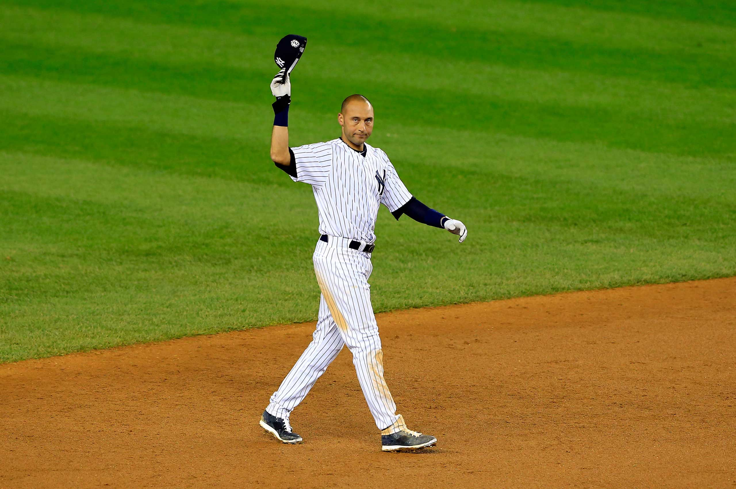 Derek Jeter gestures to the fans after a game winning RBI hit in the ninth inning against the Baltimore Orioles in his last game ever at Yankee Stadium on Sept. 25, 2014.
