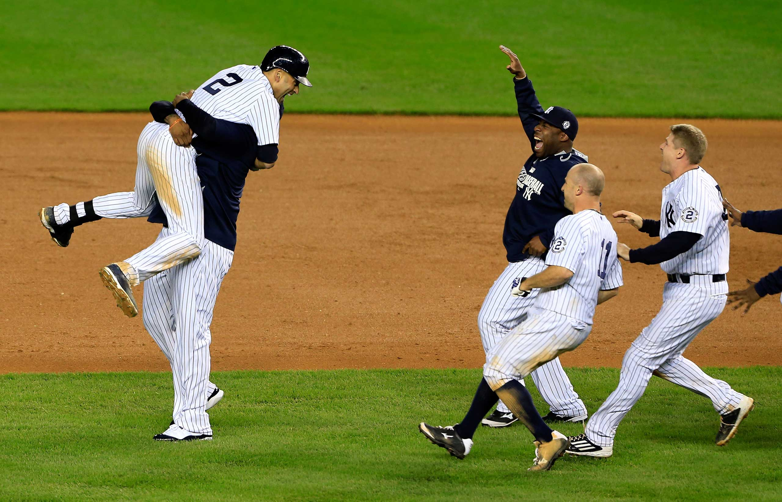 Derek Jeter celebrates with his teammates after a game winning RBI hit in the ninth inning against the Baltimore Orioles in his last game ever at Yankee Stadium on Sept. 25, 2014.