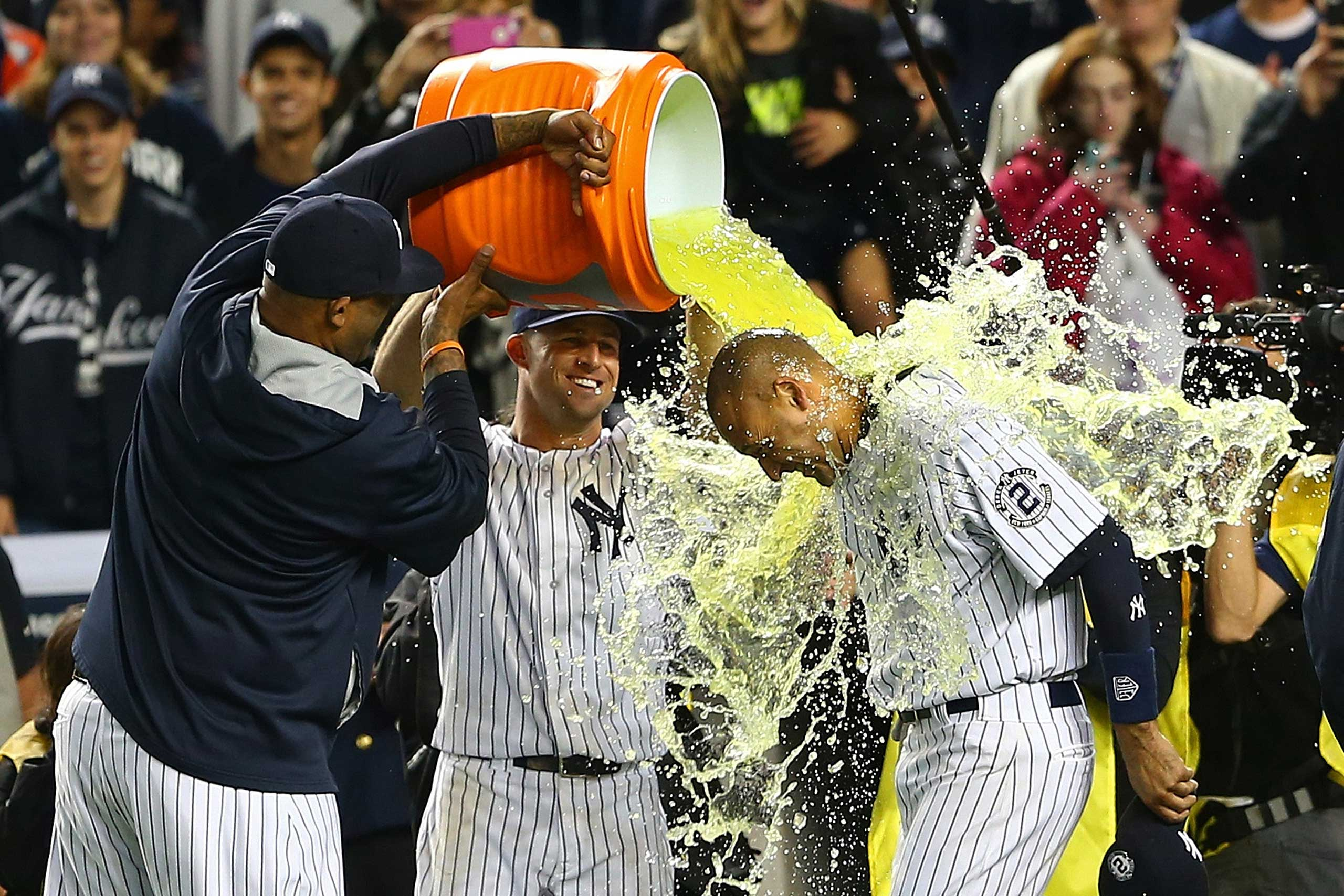 CC Sabathia and Brett Gardner dump Gatorade on Derek Jeter after he hit a game winning RBI hit in the ninth inning against the Baltimore Orioles in his last game ever at Yankee Stadium on Sept. 25, 2014.