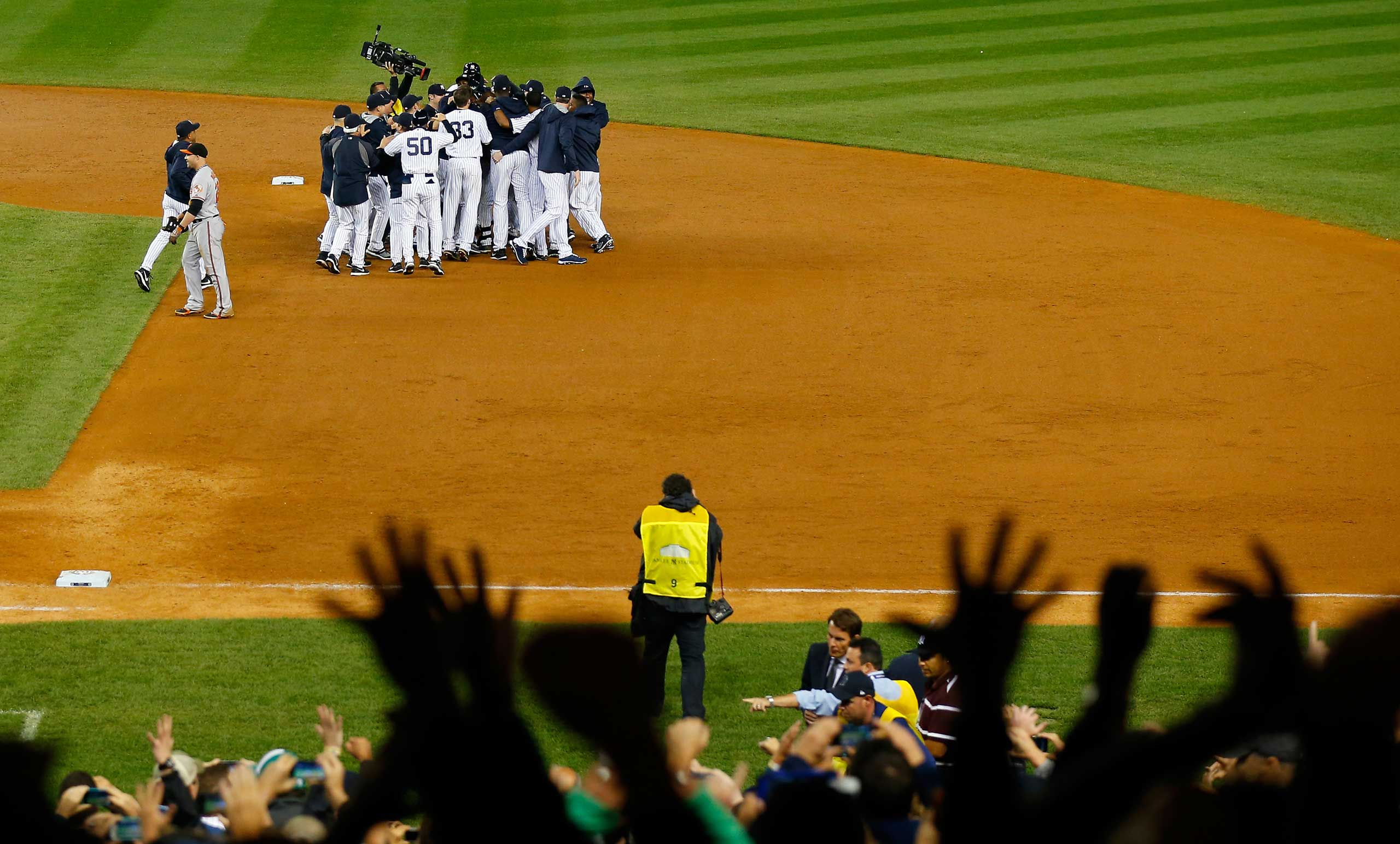 Derek Jeter celebrates with his team after a game winning RBI hit in the ninth inning against the Baltimore Orioles in his last game ever at Yankee Stadium on Sept. 25, 2014.