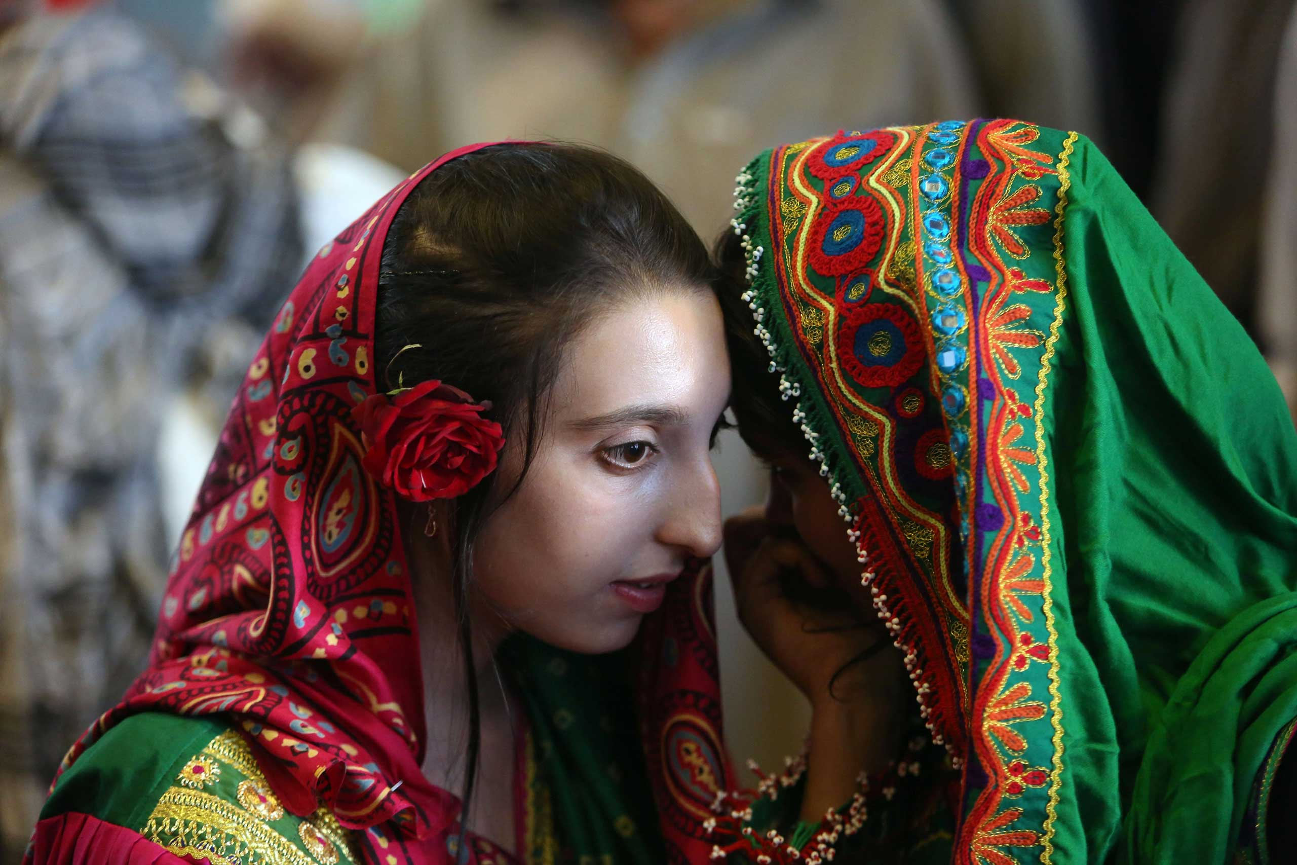 Sept. 22, 2014. Afghan girls gather to hear a speech by Ashraf Ghani Ahmadzai in his first public appearance since winning the election runoff in Kabul, Afghanistan.