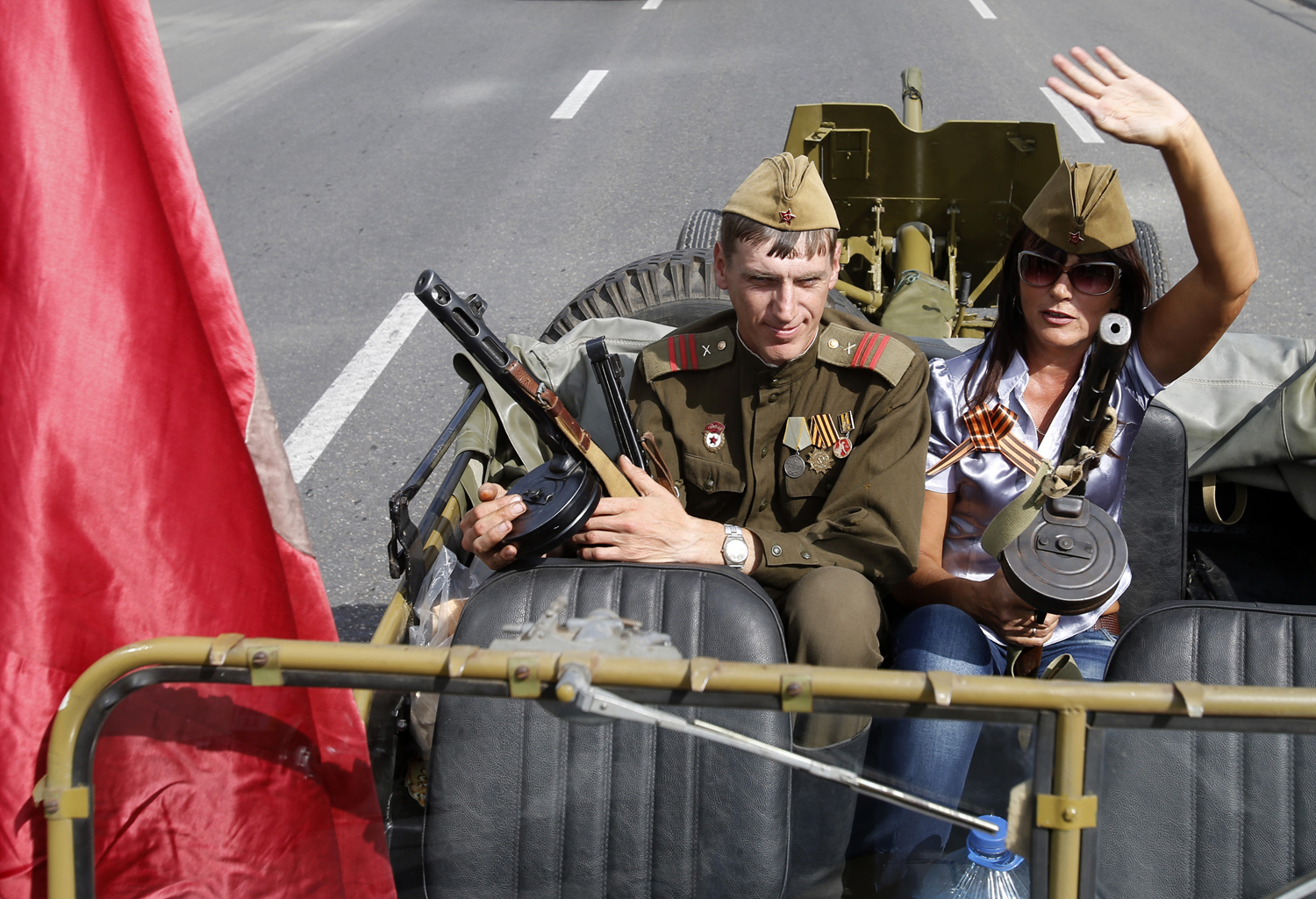 People dressed in old Soviet uniforms attend a parade in the town of Luhansk, eastern Ukraine, on Sept. 14, 2014