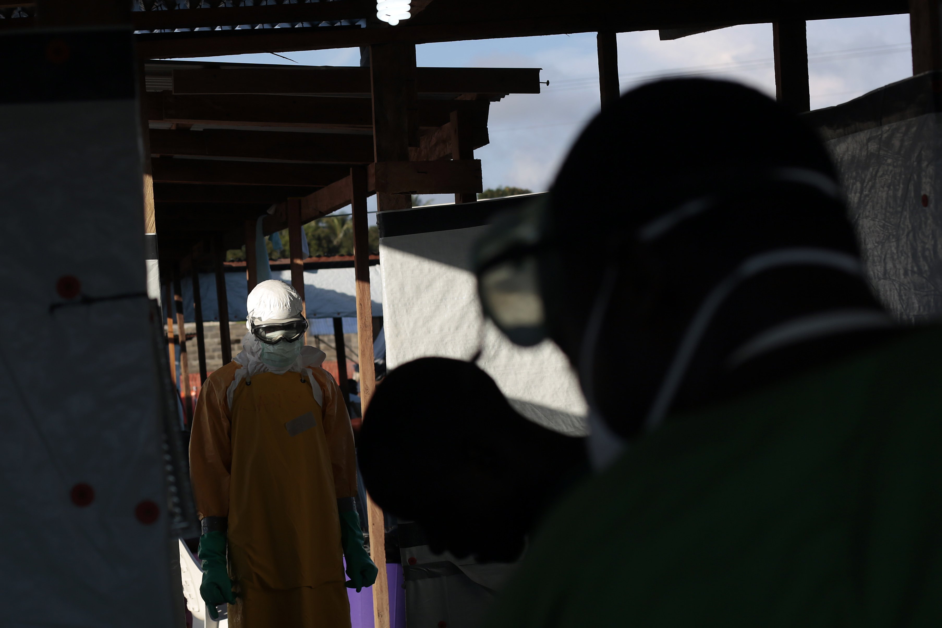 A Medecins Sans Frontieres (MSF) worker is sprayed and disinfected as he leaves a high risk zone of MSF's  Ebola isolation and treatment center in Monrovia, Liberia, Sept. 29, 2014.