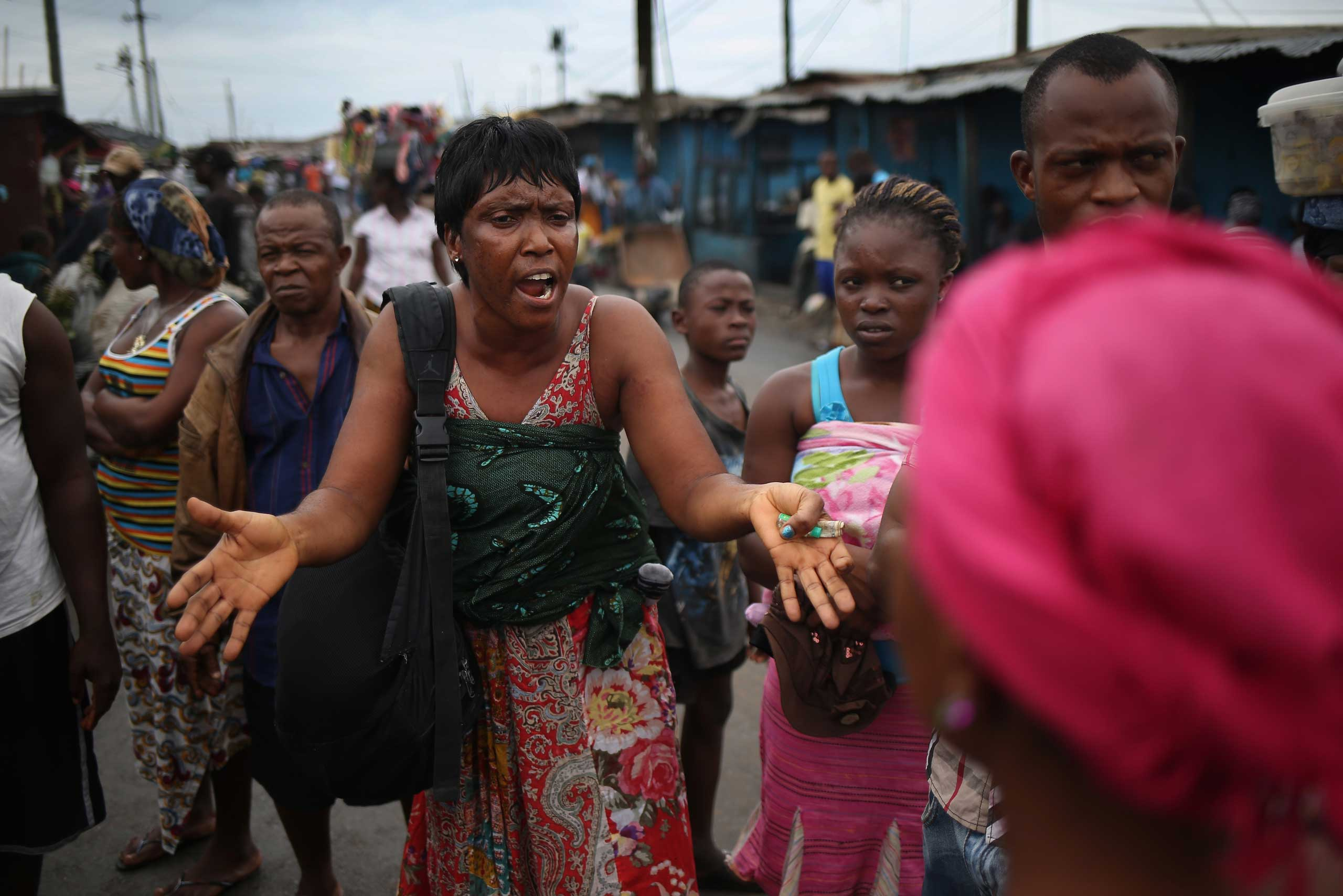 Batu Flowers tries to convince local residents that the Ebola epidemic is real on Aug. 16, 2014 in Monrovia.