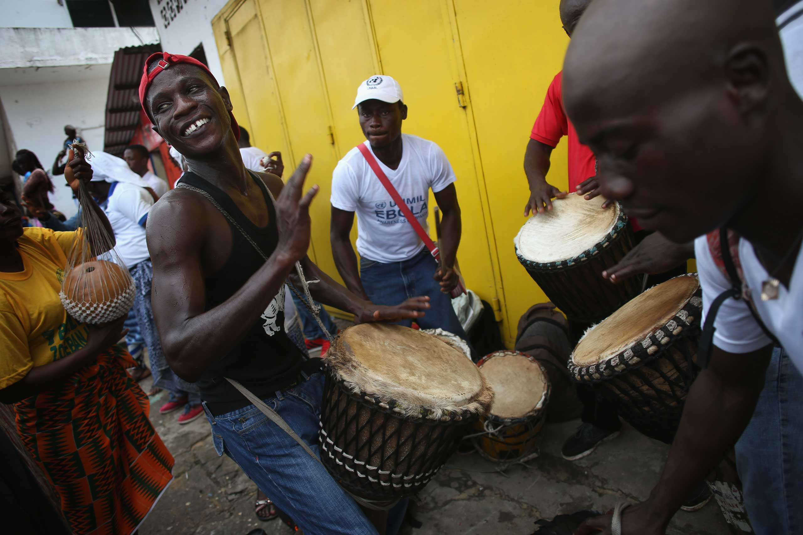 Public health advocates play music to attract people for an Ebola awareness and prevention event on Aug. 18, 2014 in Monrovia.