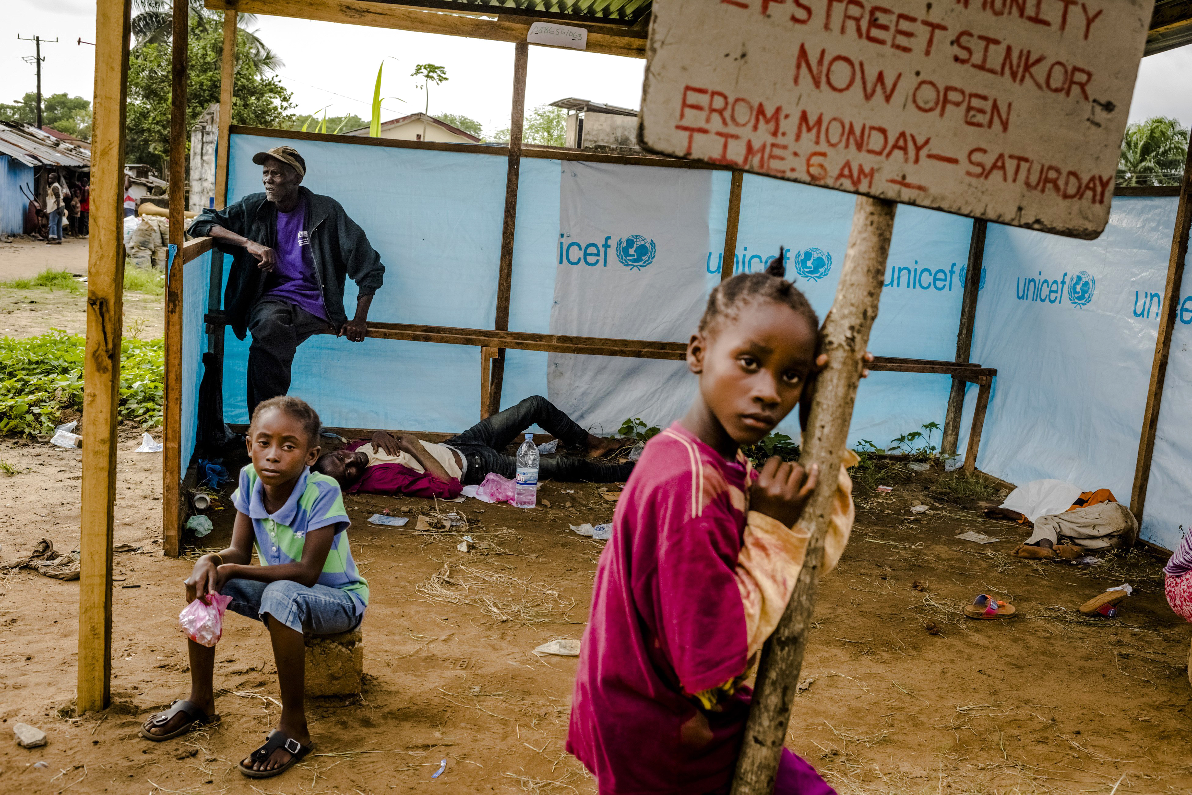 People wait to be admitted into an Ebola treatment facility in Monrovia, Liberia, on Sept. 5, 2014.