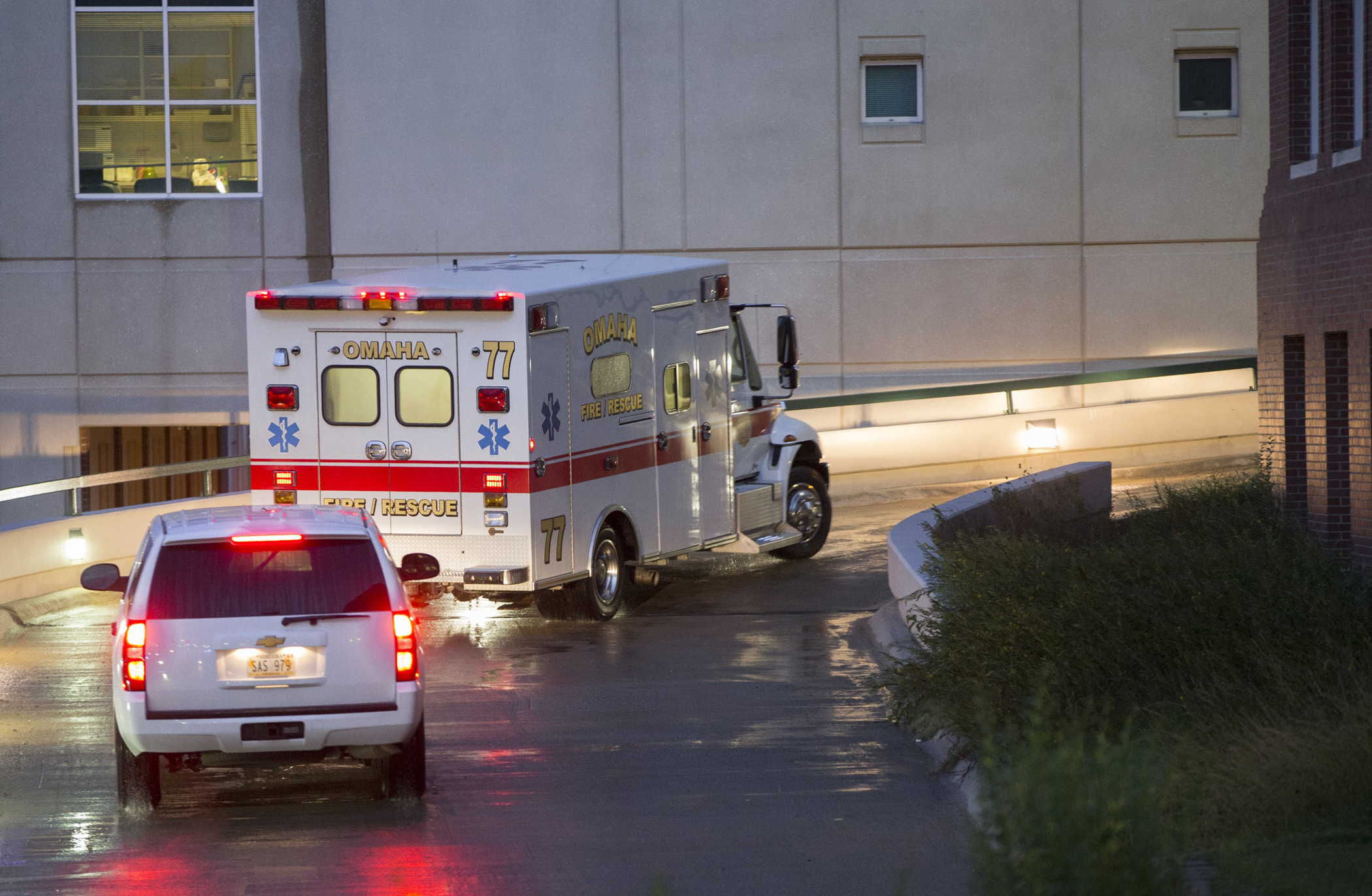 The ambulance transporting Dr. Rick Sacra, 51, who was infected with Ebola while serving as an obstetrician in Liberia, arrives to the Nebraska Medical Center in Omaha, Neb., Sept. 5, 2014.