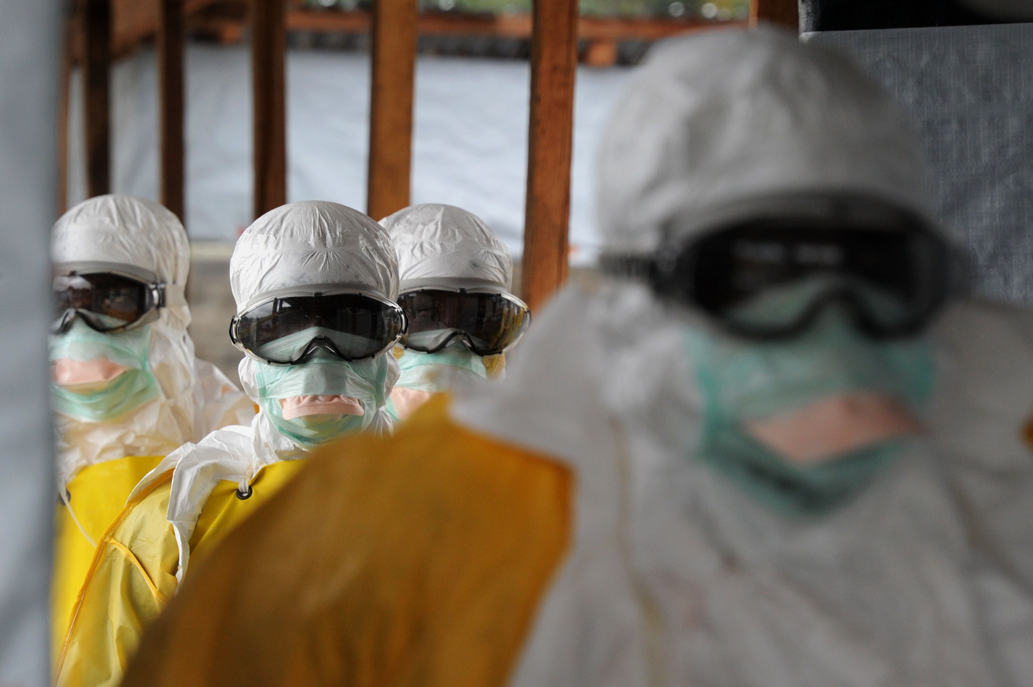 Health care workers, wearing protective suits, leave a high-risk area at the French NGO Medecins Sans Frontieres (Doctors without borders) Elwa hospital in Monrovia, Liberia on Aug. 30, 2014.