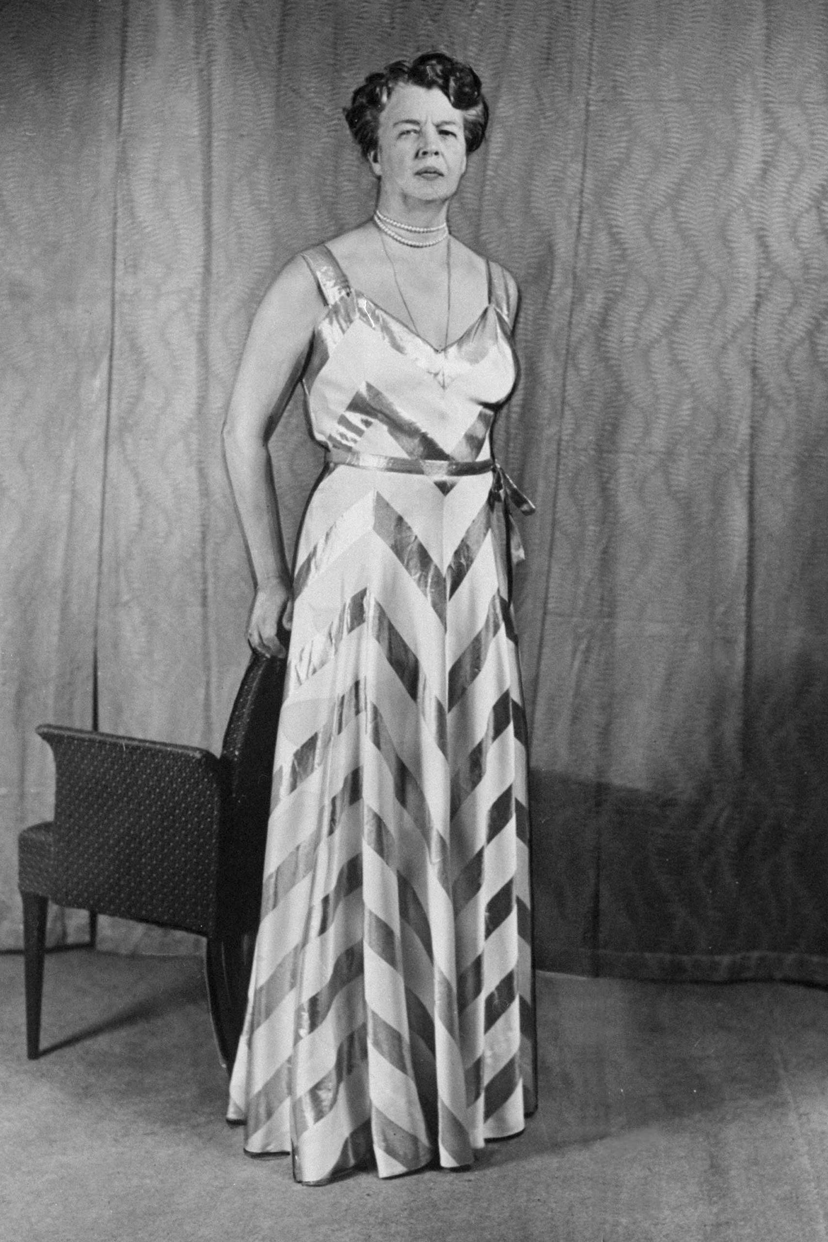 Eleanor Roosevelt wears the Arnold Constable gown she will wear to the White House diplomatic corps reception, Nov. 10, 1939.