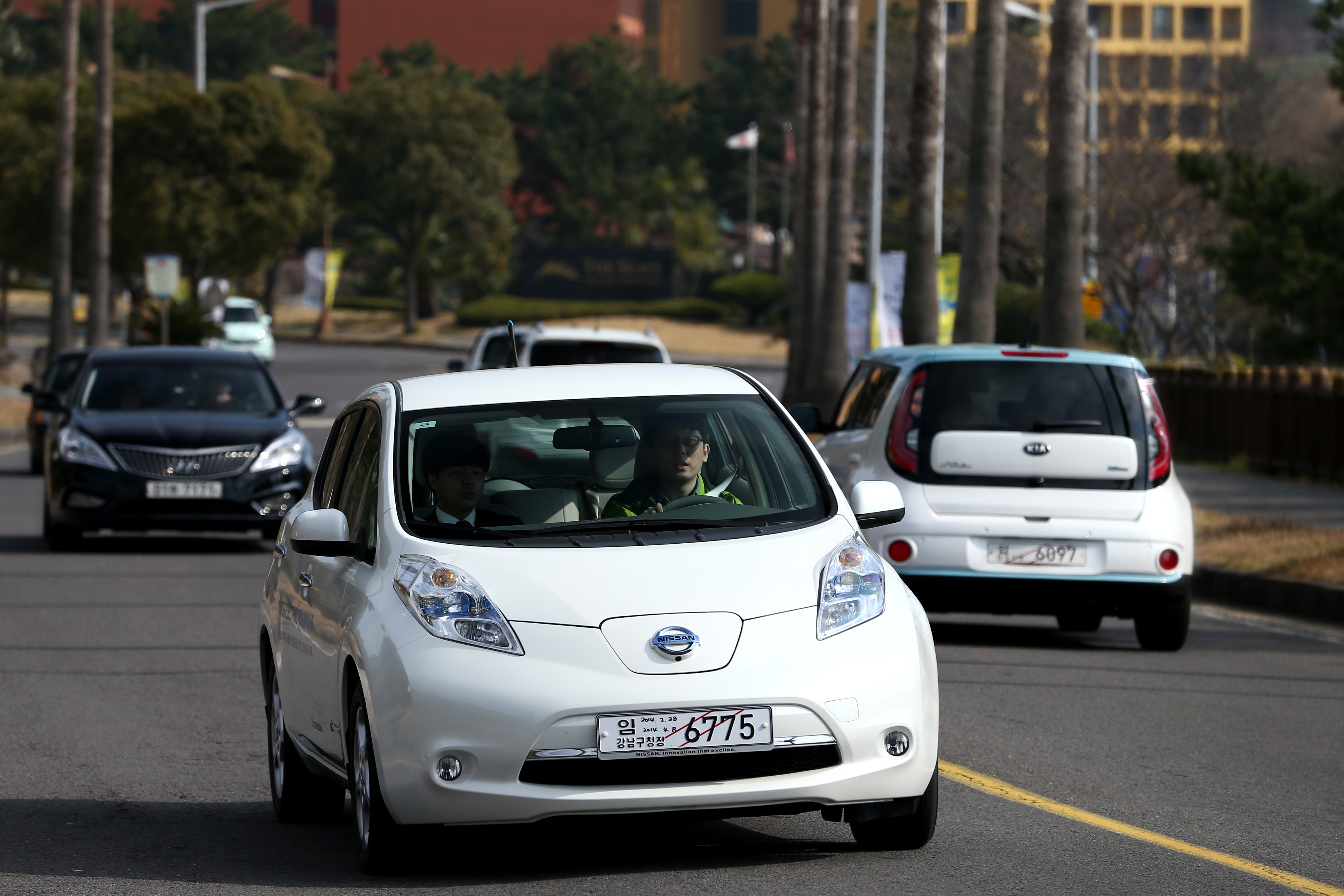 A Nissan Motor Co. Leaf electric vehicle (EV) is driven for a test drive during the first International Electric Vehicle Expo.