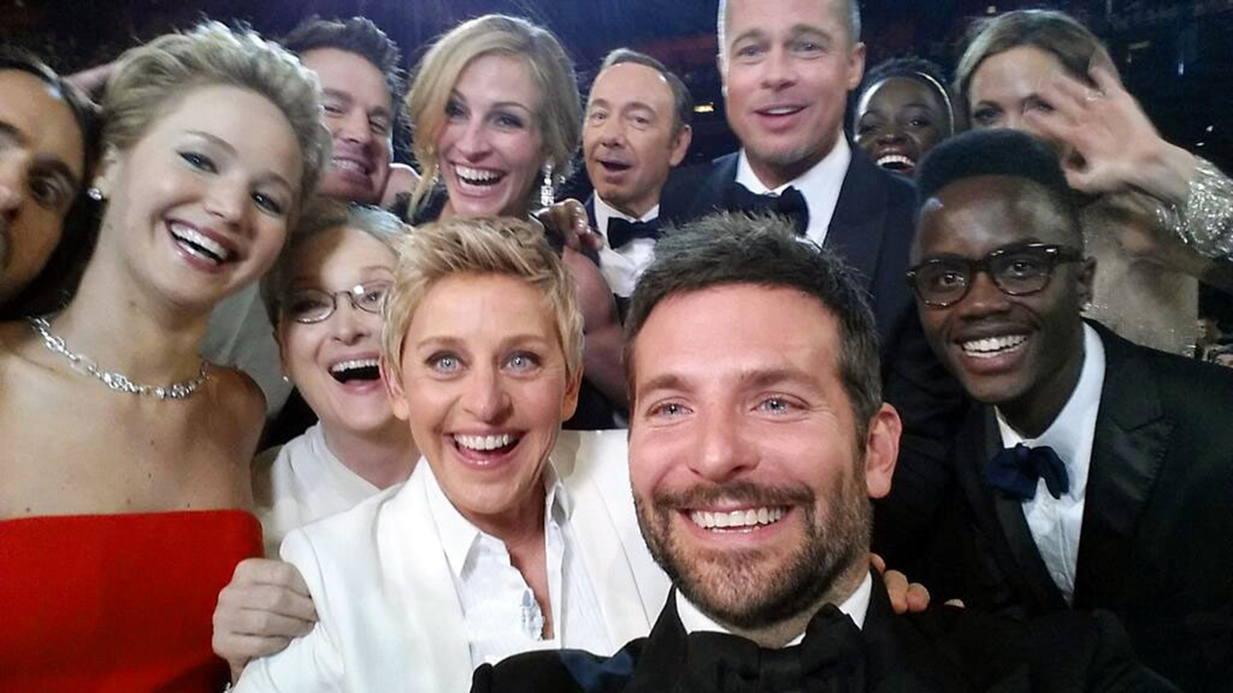 This image released by Ellen DeGeneres shows actors, front row from left, Jared Leto, Jennifer Lawrence, Meryl Streep, Ellen DeGeneres, Bradley Cooper, Peter Nyong'o Jr. and, second row, from left, Channing Tatum, Julia Roberts, Kevin Spacey, Brad Pitt, Lupita Nyong'o and Angelina Jolie as they pose for a  selfie  portrait on a cell phone during the Oscars at the Dolby Theatre on Sunday, March 2, 2014, in Los Angeles.