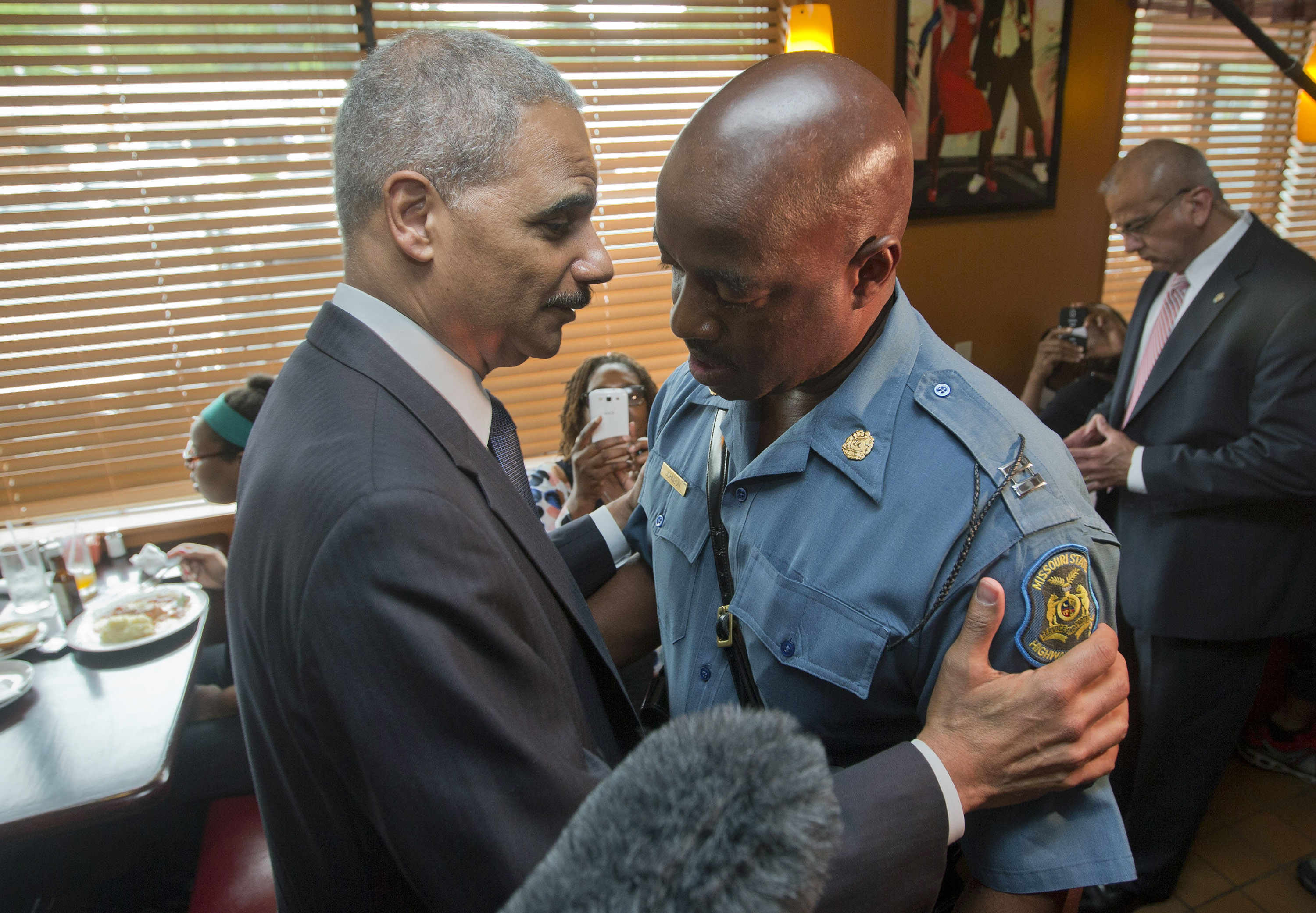 U.S. Attorney General Eric Holder appeared with Capt. Ron Johnson  at Drake's Place Restaurant in Ferguson on Aug. 20, 2014. Holder's visit was meant to calm tensions after almost 10 days of protests.