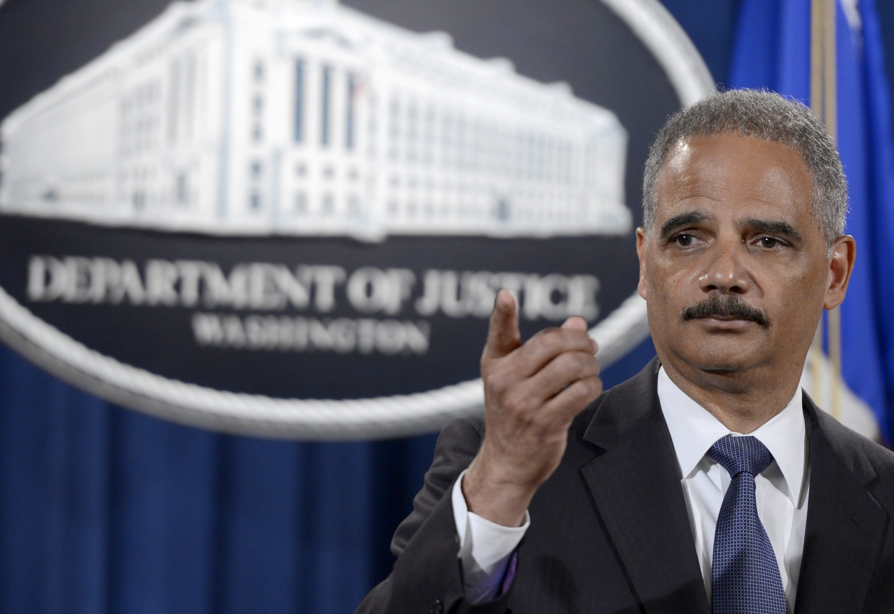 US Attorney General Eric Holder responds to a question from the news media on the Justice Department's efforts in Ferguson, Missouri during a press conference at the Justice Department in Washington, DC, on Sept. 4, 2014.