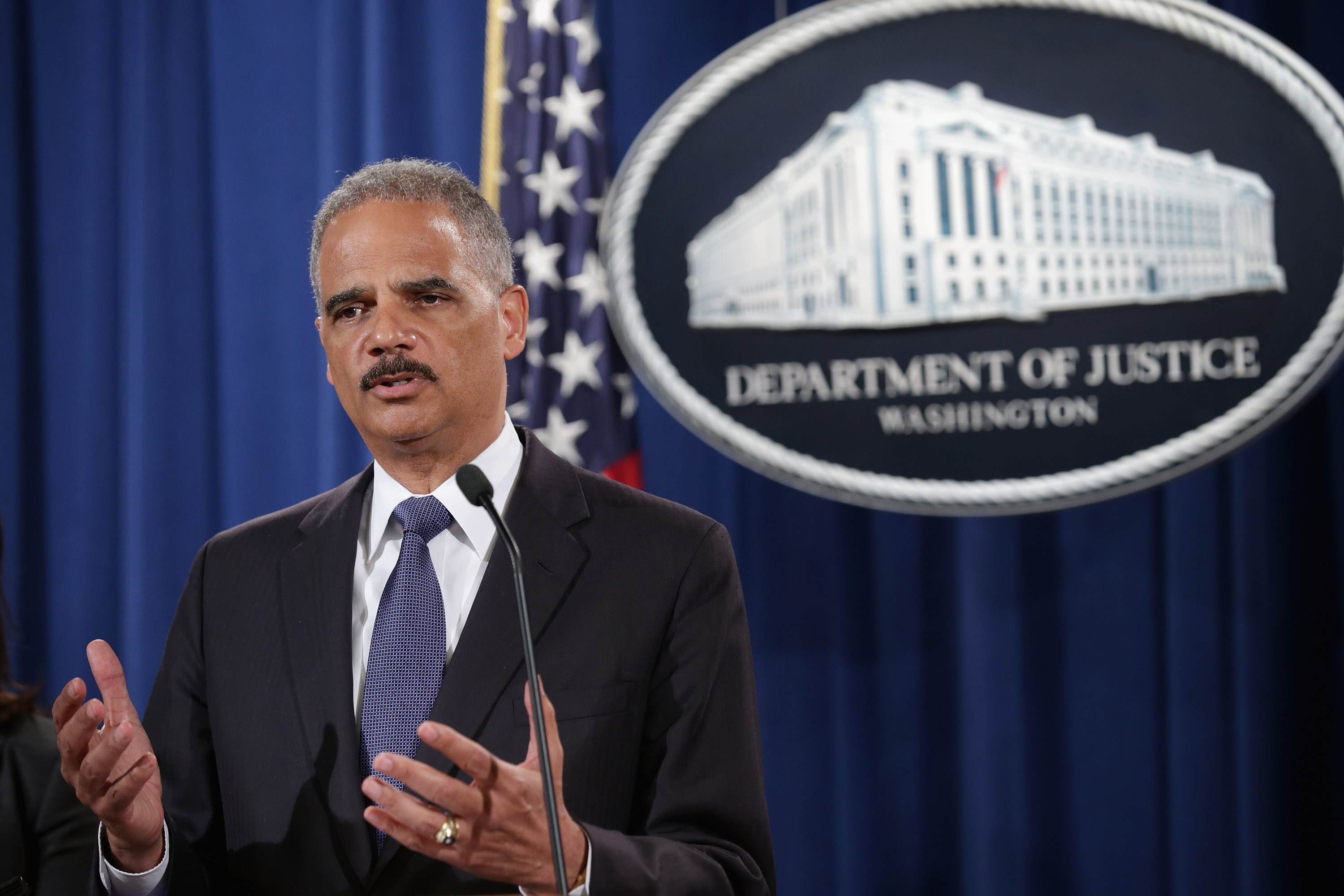 U.S. Attorney General Eric Holder announces a Justice Department 'patterns and practice' investigation of the Ferguson, Missouri, police department during a news conference at the department's headquarters Sept. 4, 2014 in Washington, DC.
