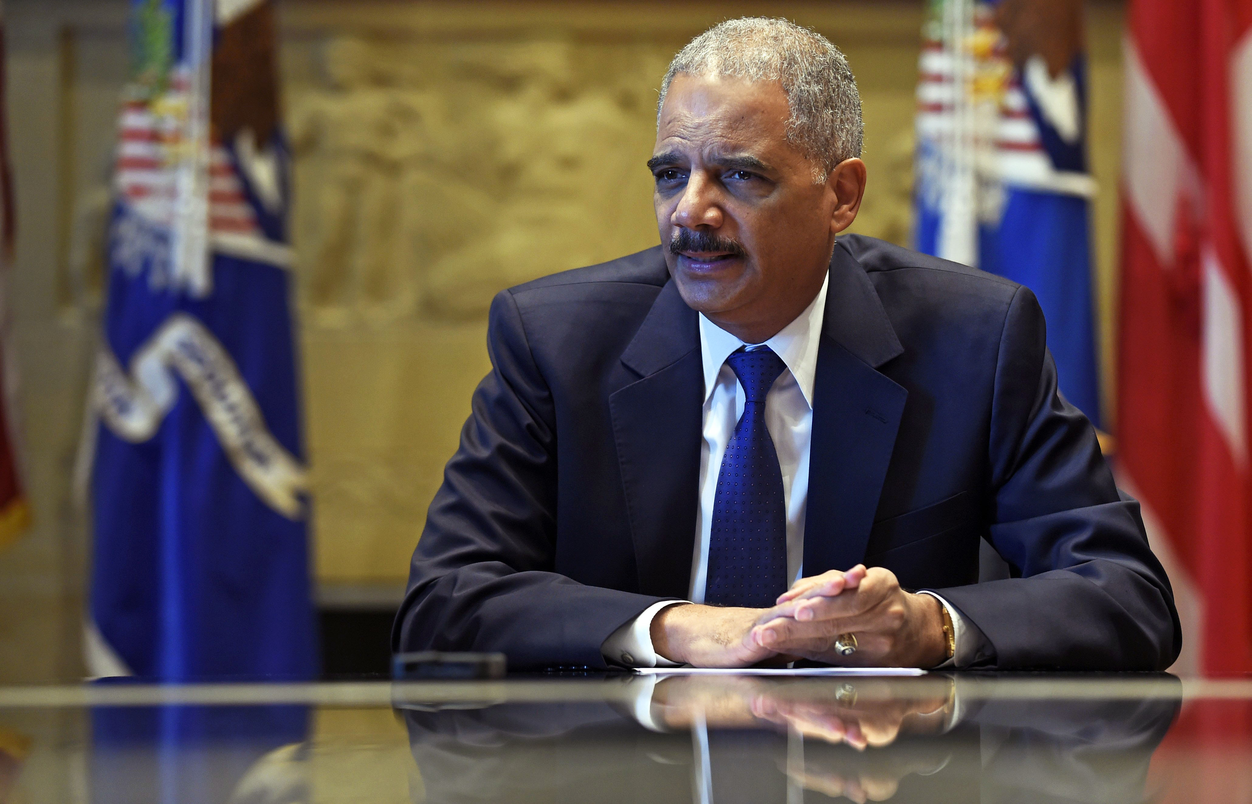 Attorney General Eric Holder speaks during an interview with The Associated Press at the Justice Department in Washington, on Sept. 16, 2014.
