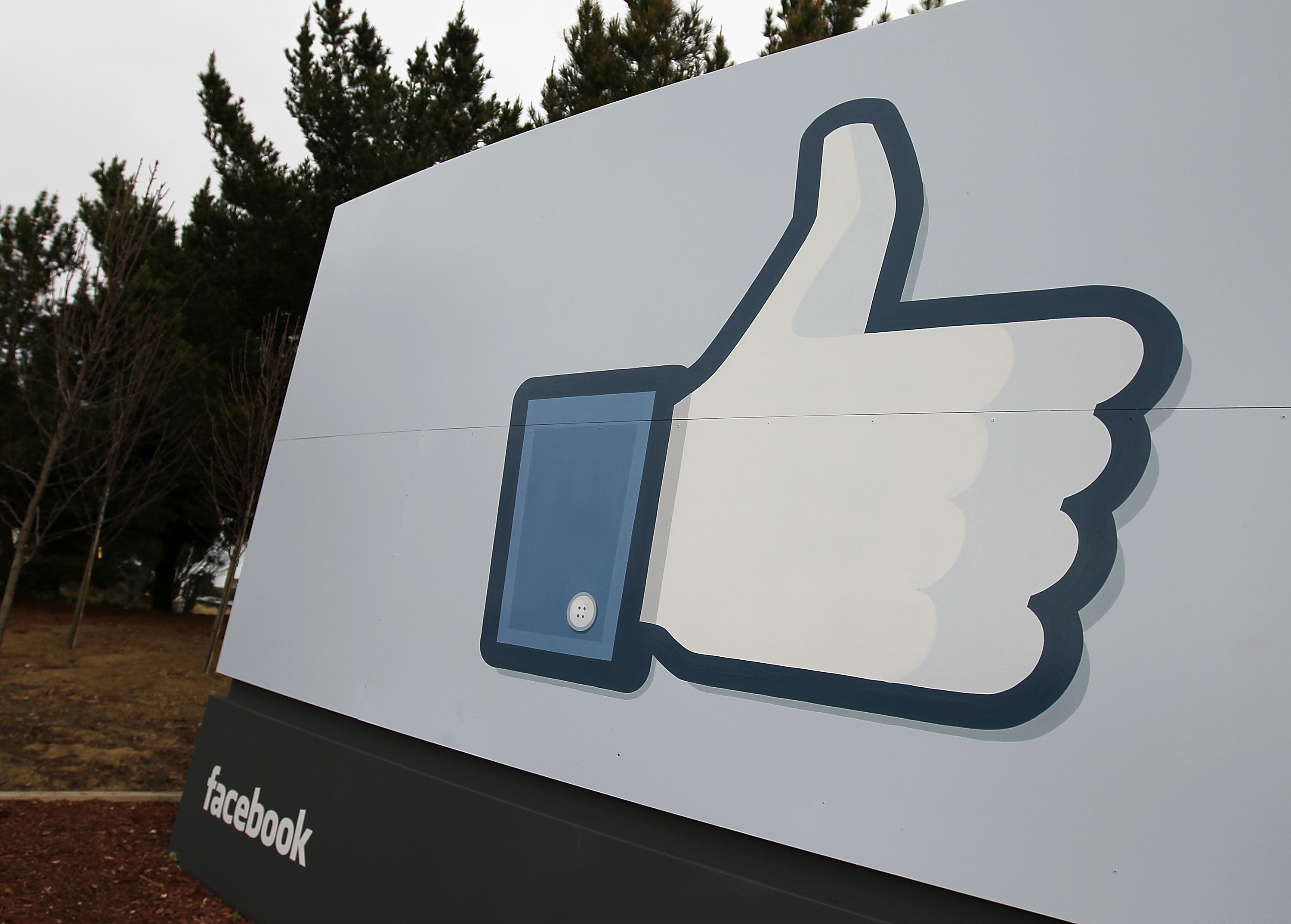 A sign with the  like  symbol stands in front of the Facebook headquarters on February 1, 2012 in Menlo Park, California.
