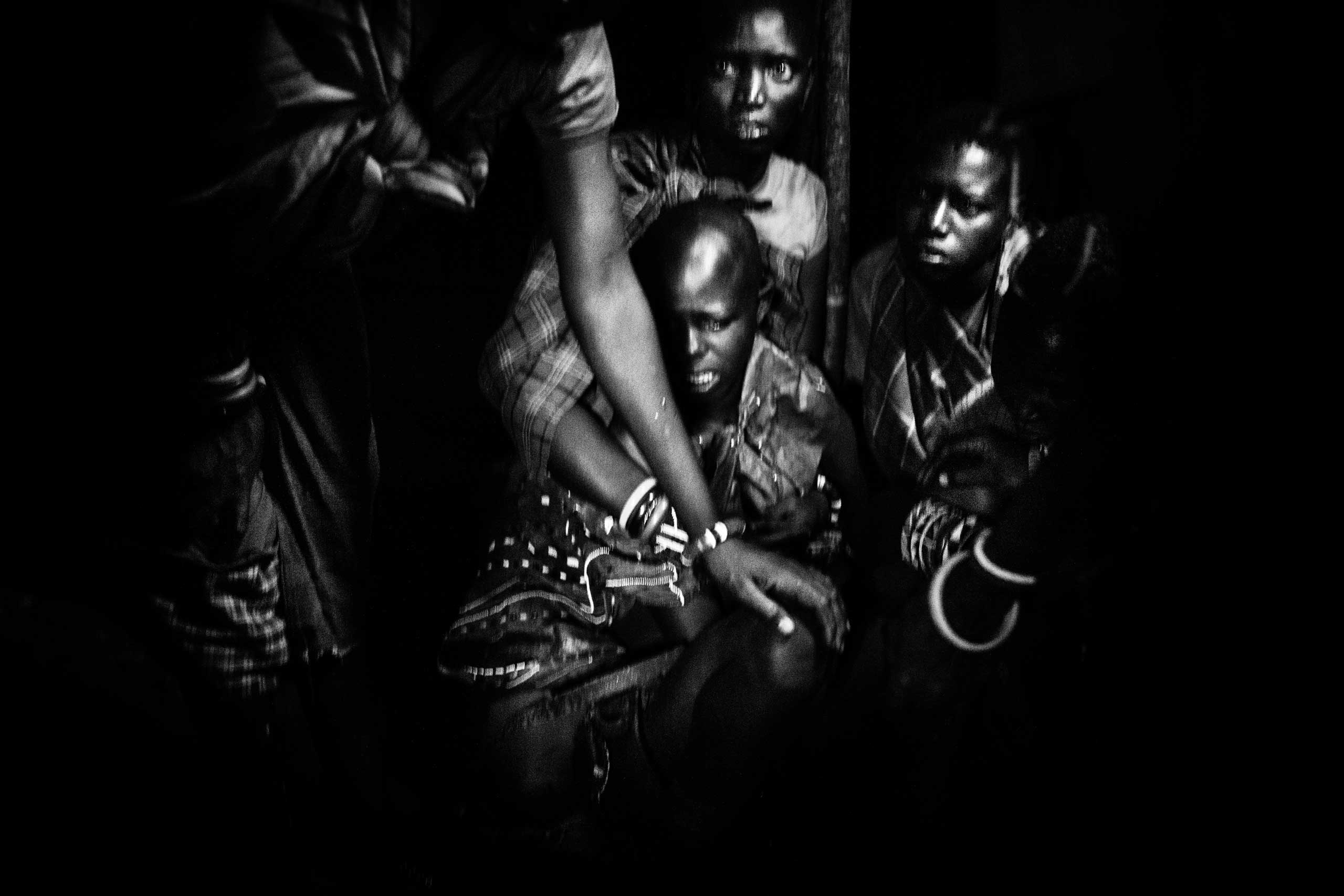 Nasirian cries at the start of the circumcision.