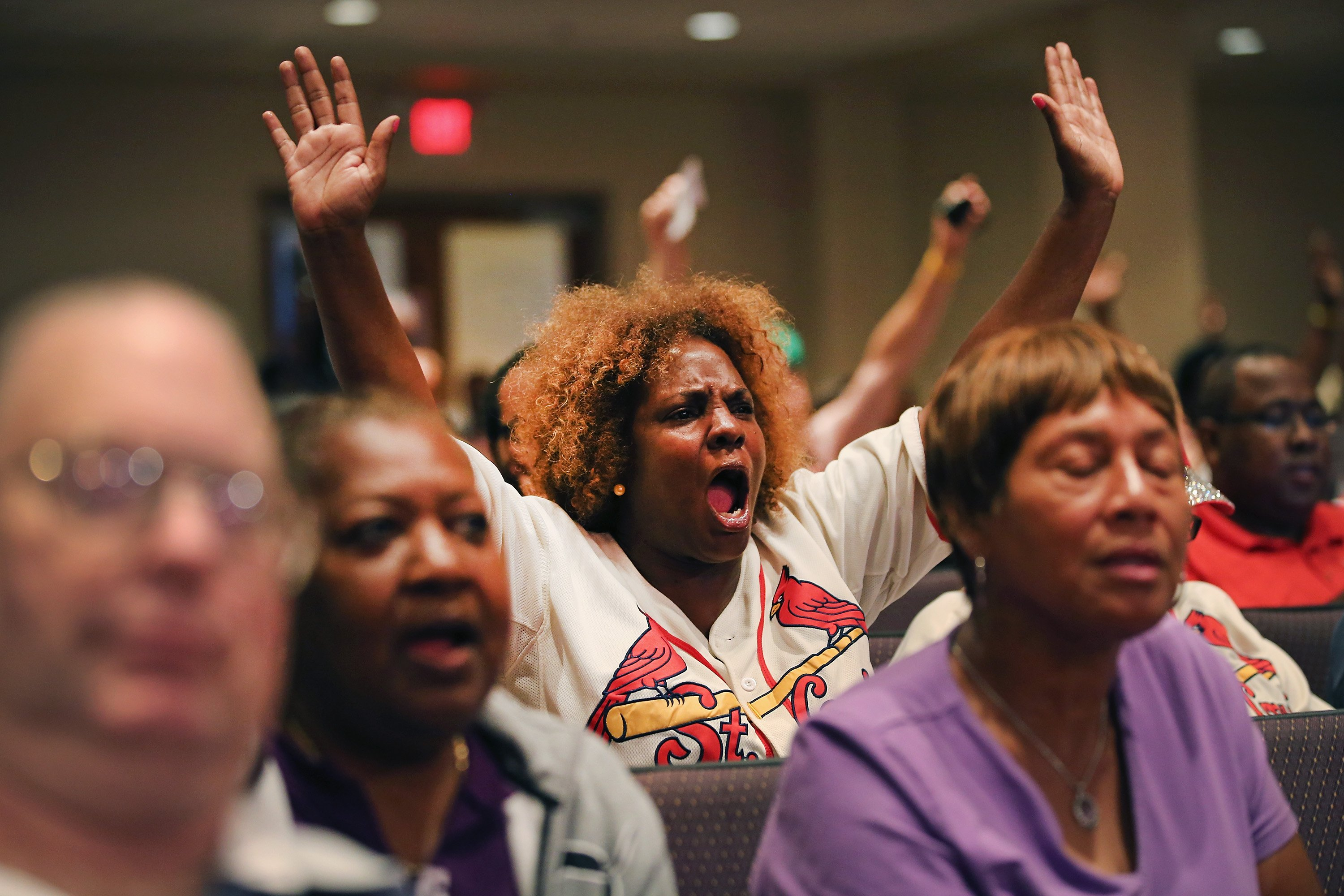 Residents shout out during the Ferguson city-council meeting on Sept. 9, 2014, in Ferguson, Mo.