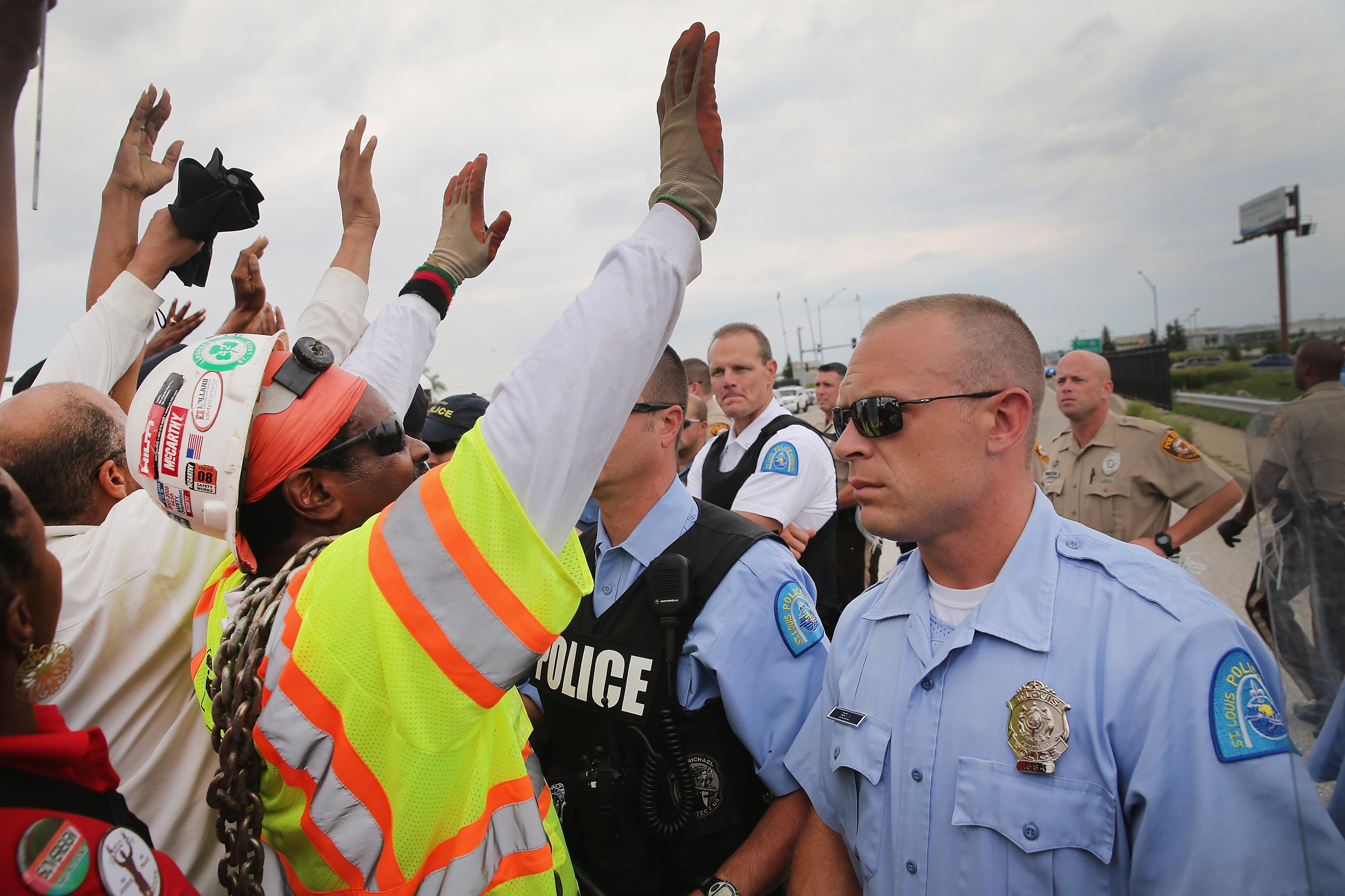 Police block demonstrators from gaining access to Interstate Highway 70 on Sept. 10, 2014 near Ferguson, Mo.
