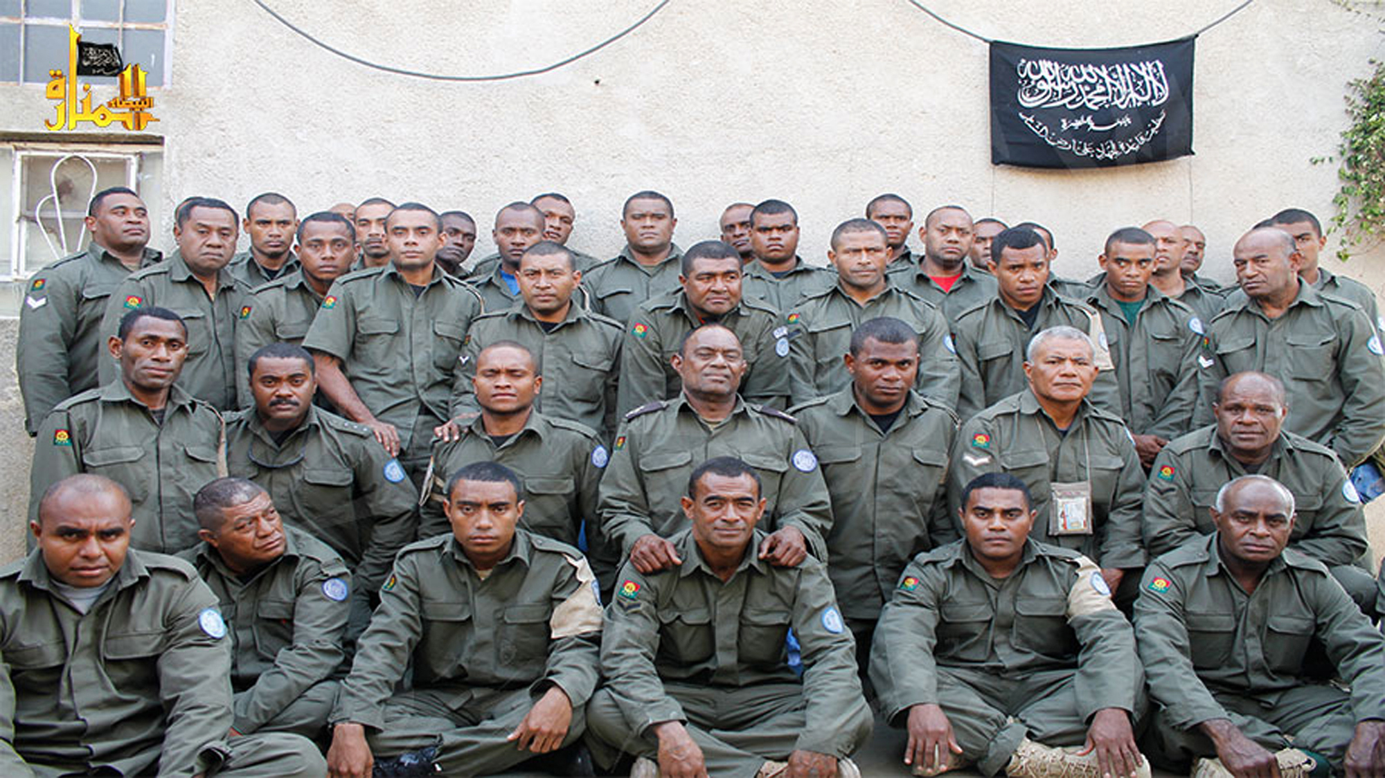 Undated photograph released by Hanin Network, a militant website, shows Fijian UN peacekeepers who were seized by The Nusra Front on Aug. 28, 2014, in the Golan Heights.