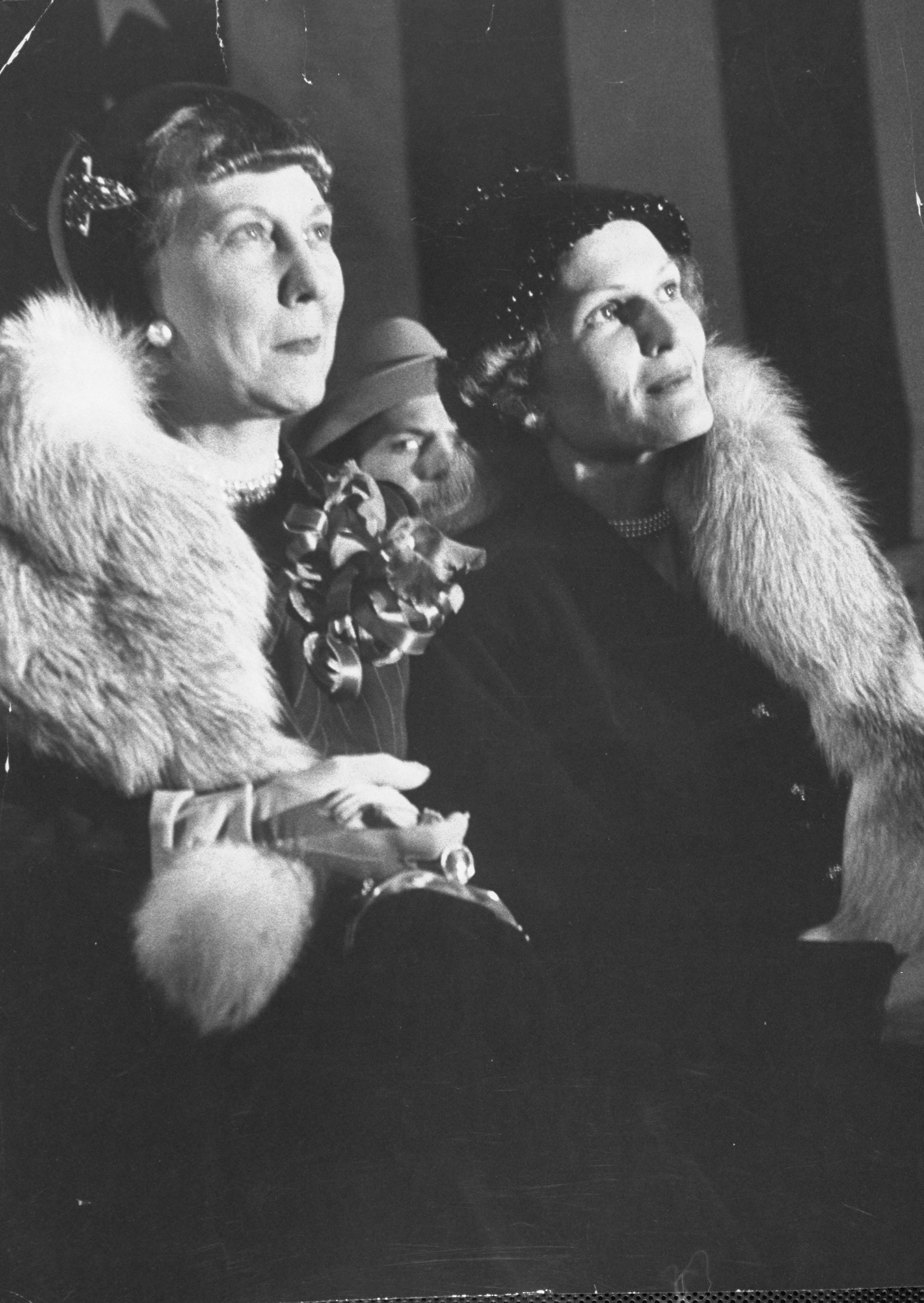 Mrs. Mamie Eisenhower (L) sharing her fur with Mrs. Patricia Nixon on a chilly night in 1952.