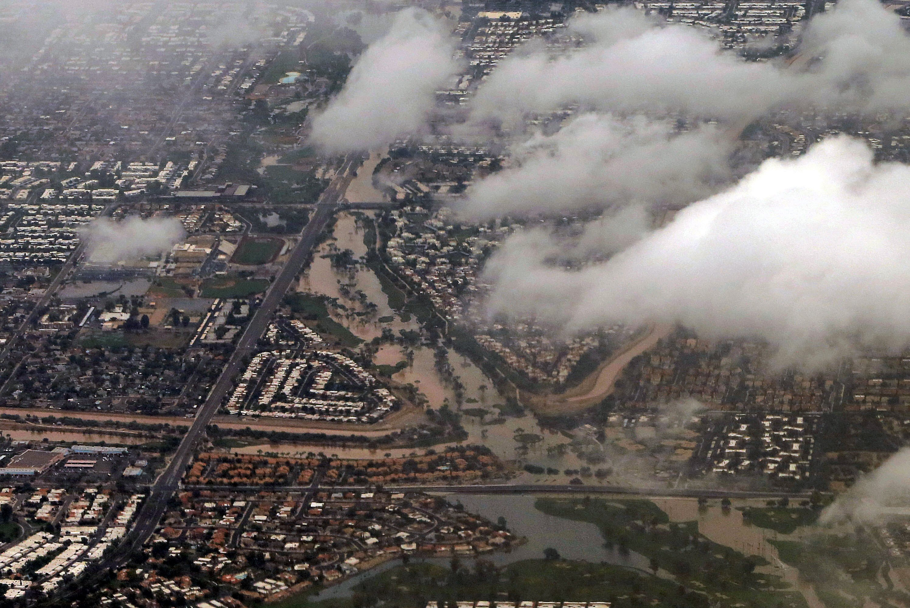 A section of Scottsdale, Ariz. appears flooded following heavy rains that left motorists stranded during their morning commute, Sept. 8, 2014.