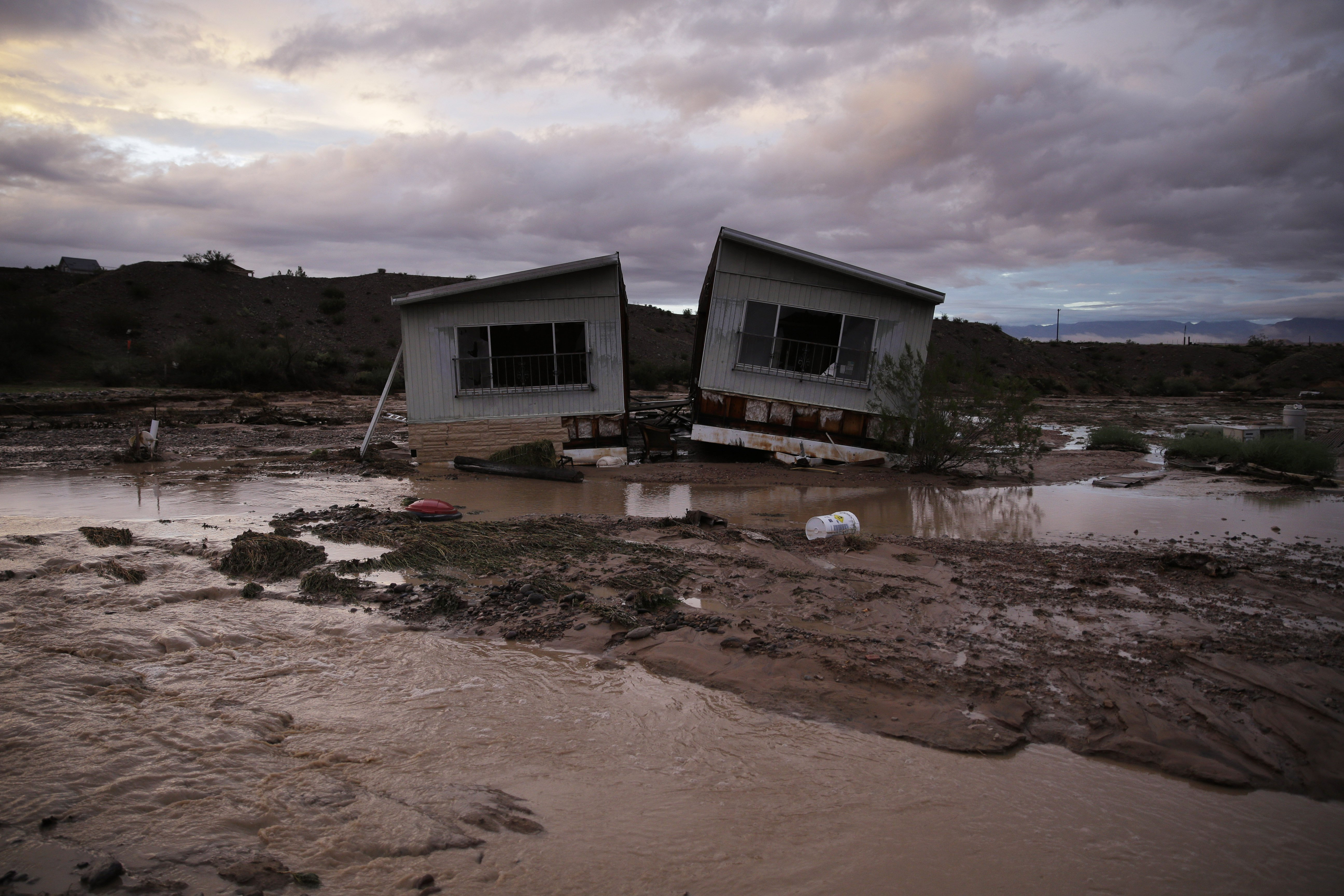 Receding flood water surrounds a home in Moapa, Nev., Sept. 8, 2014.