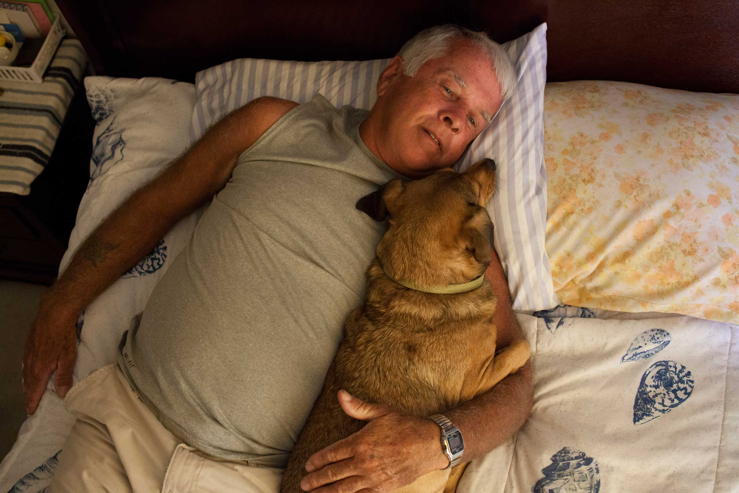 Gene laying down with his dog Killer for a nap.                                                               Only a fool would truly trust anyone if you are a sex offender.