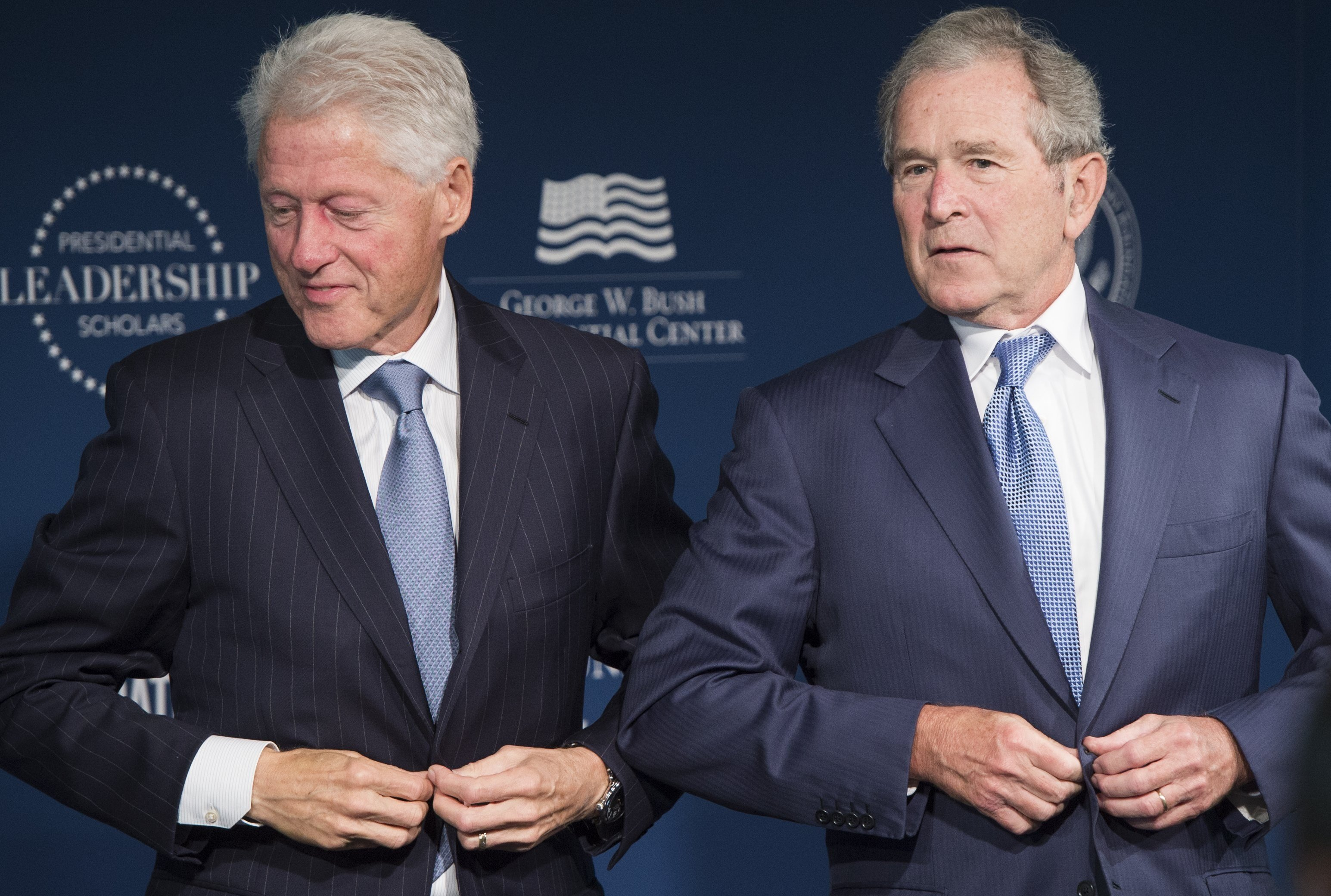 Former US President Bill Clinton and former US President George W. Bush stand to leave after speaking during the launch of the Presidential Leadership Scholars Program at the Newseum in Washington on Sept. 8, 2014.