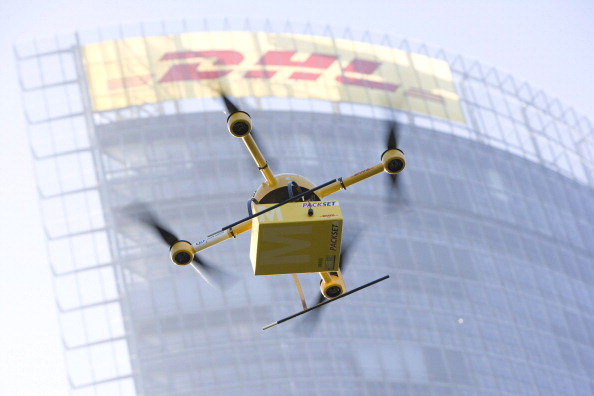 A drone with a small delivery flies at the Deutsche Post/DHL  headquarters on December 10, 2013 in Bonn, Germany.