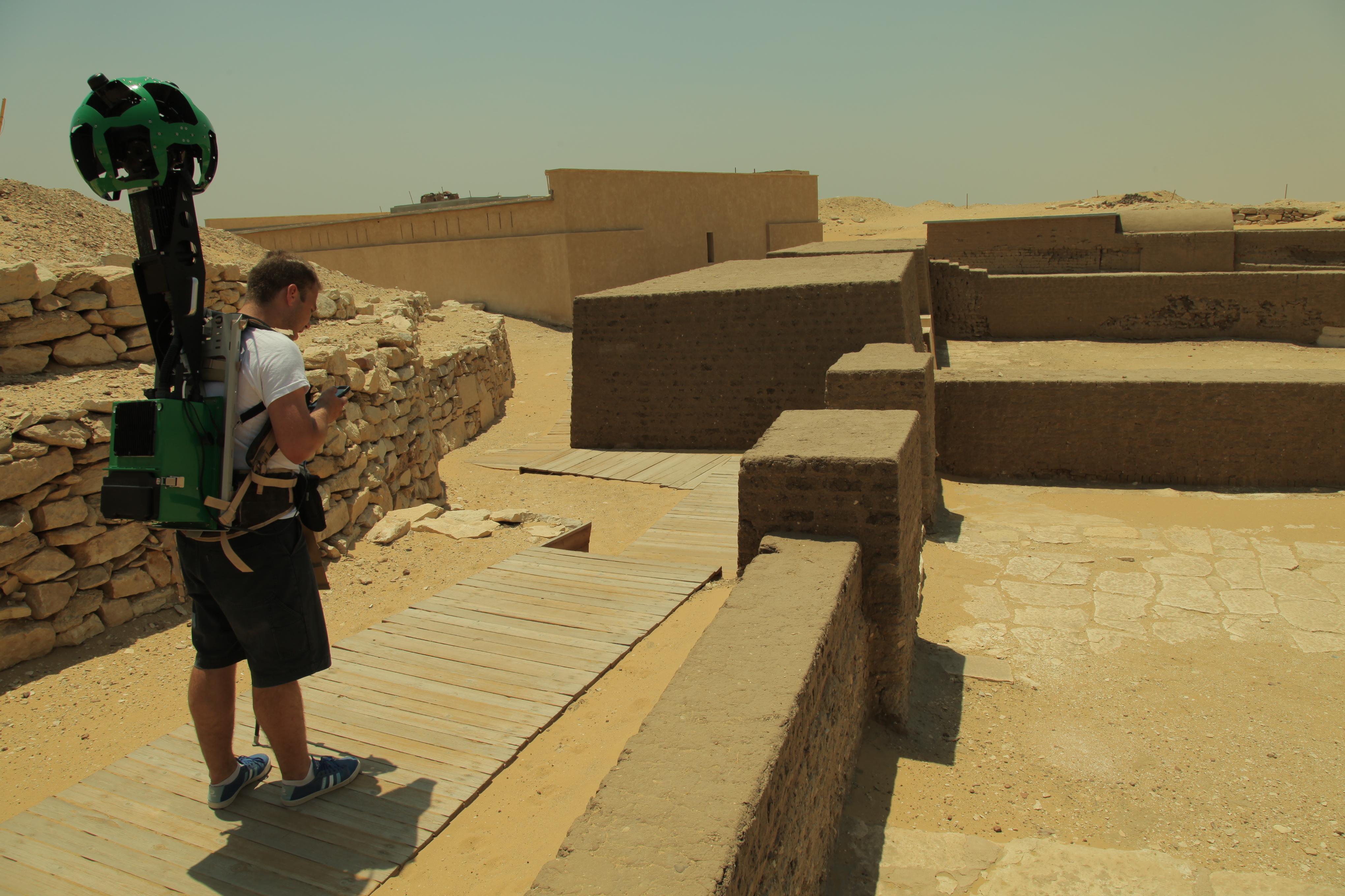 A Street View operations team member wearing a Trekker in Saqqara, Egypt.
