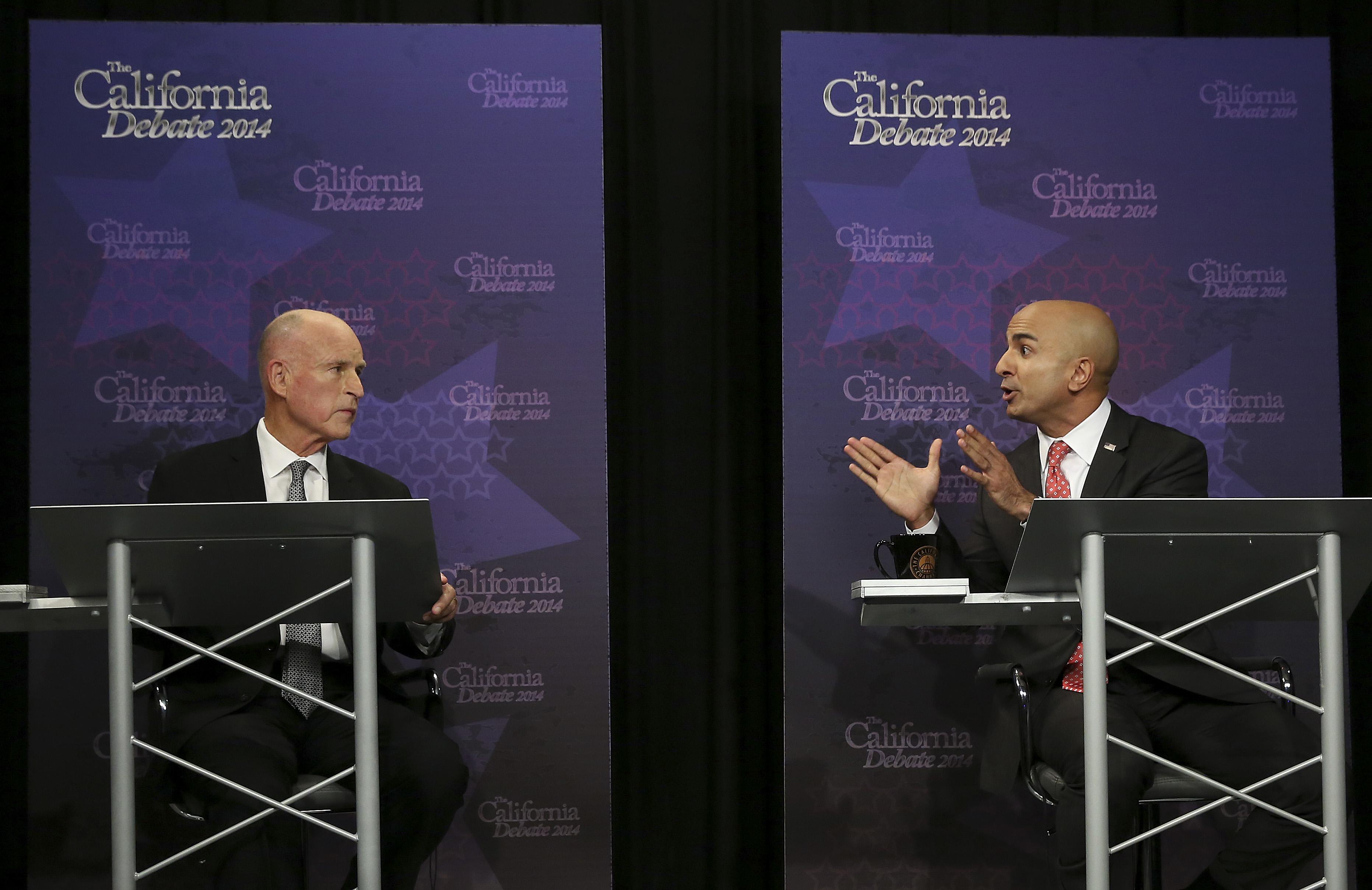 California Governor JerryBrown, left, listens as Republican challenger Neel Kashkari speaks during a gubernatorial debate in Sacramento, Calif., on Sept. 4, 2014