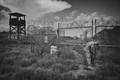 A public affairs representative at Camp X-Ray for a tour of the defunct facility during a media visit to the Guantanamo Bay U.S. Naval Base in Cuba.