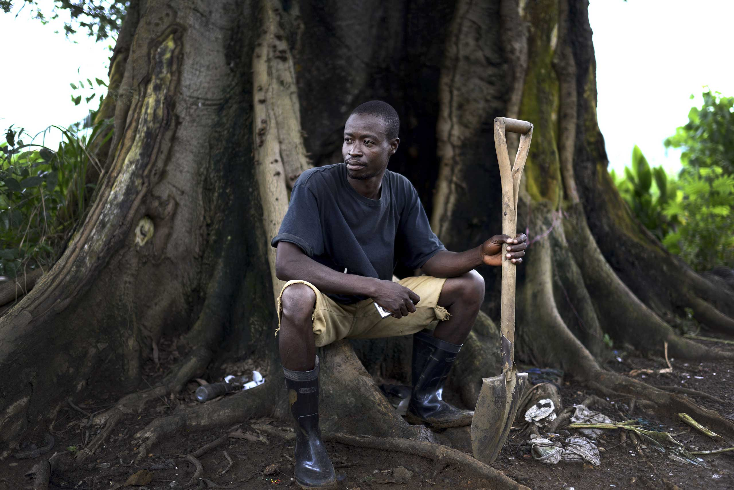Sept. 21, 2014. James Hamilton, the chief grave-digger at King Tom Cemetery, which is bitterly resented by residents of the adjoining slum, called Kolleh Town  by its residents, in Freetown, Sierra Leone.