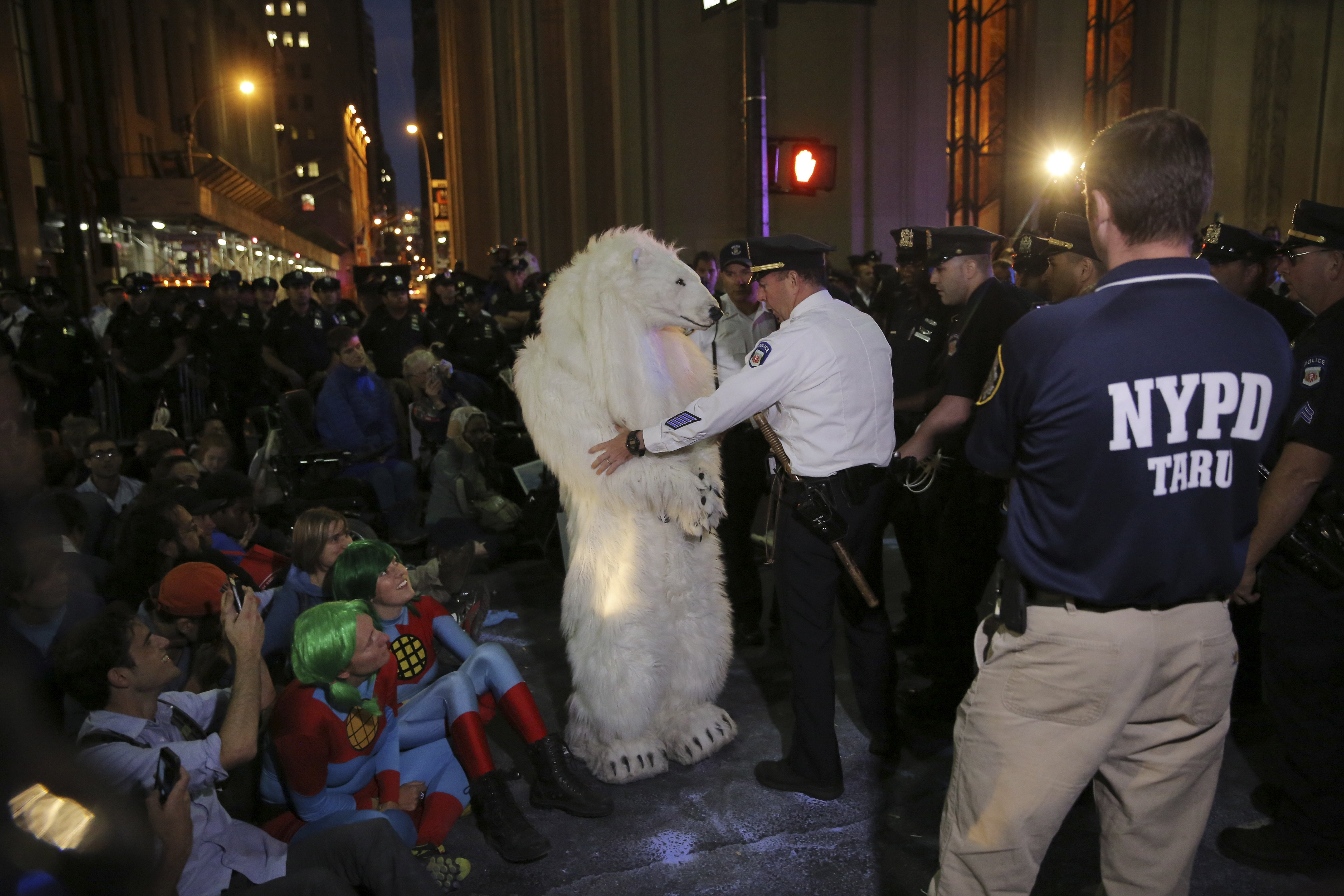 Police arrest a demonstrator dressed in a polar bear costume during the  Flood Wall Street  protest to bring awareness to climate change, in New York on Sept. 22, 2014.