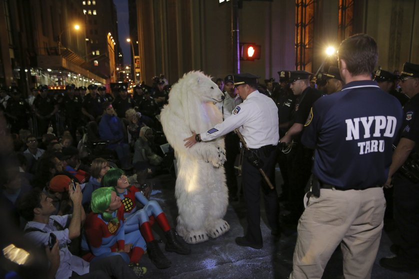 "Police arrest a demonstrator dressed in a polar bear costume during the ""Flood Wall Street"" protest to bring awareness to climate change, in New York on Sept. 22, 2014."