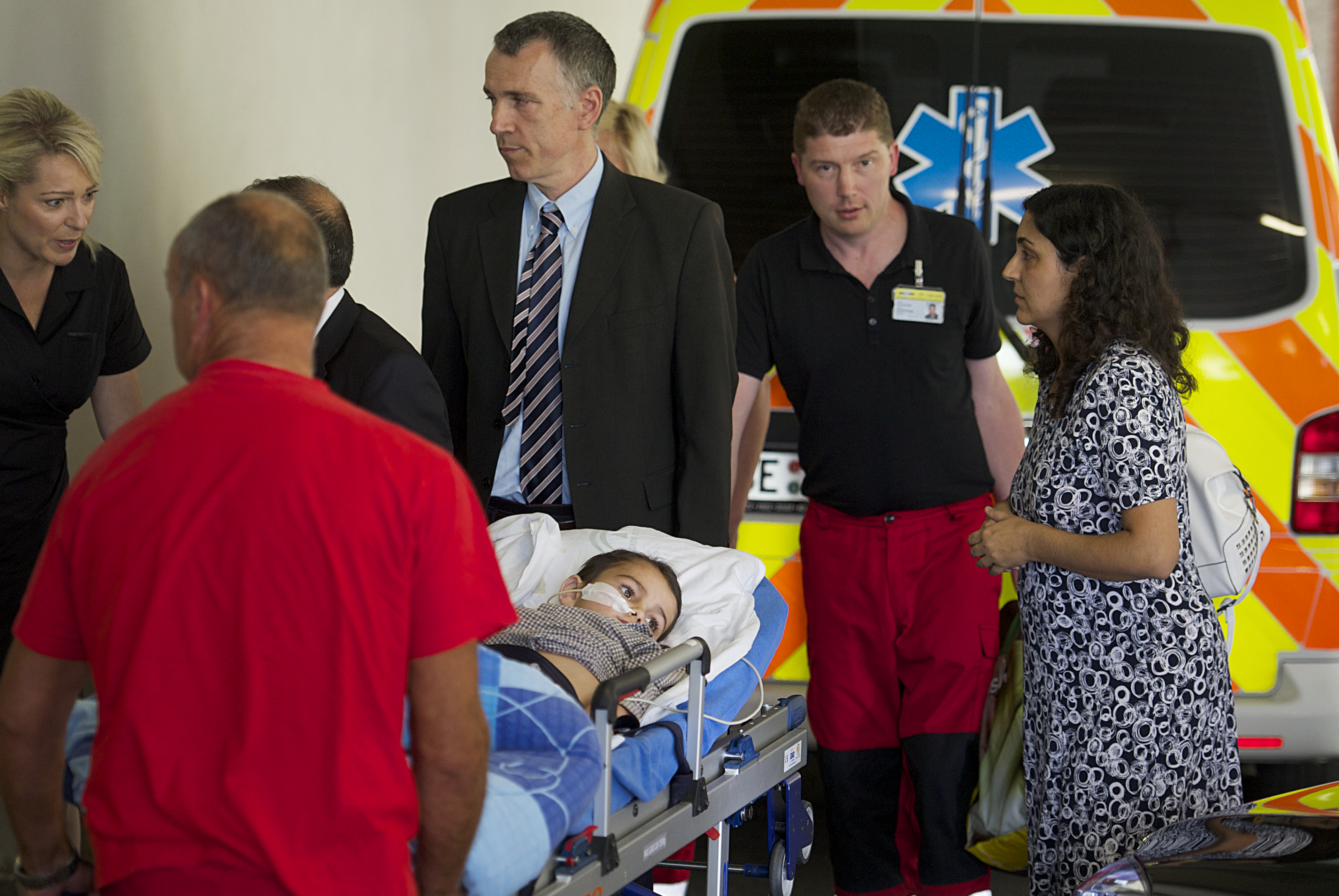 Five-year-old Ashya King is accompanied by his parents Brett, left, and Naghmeh King, right, on his arrival at the Motol hospital in Prague on Sept. 8, 2014