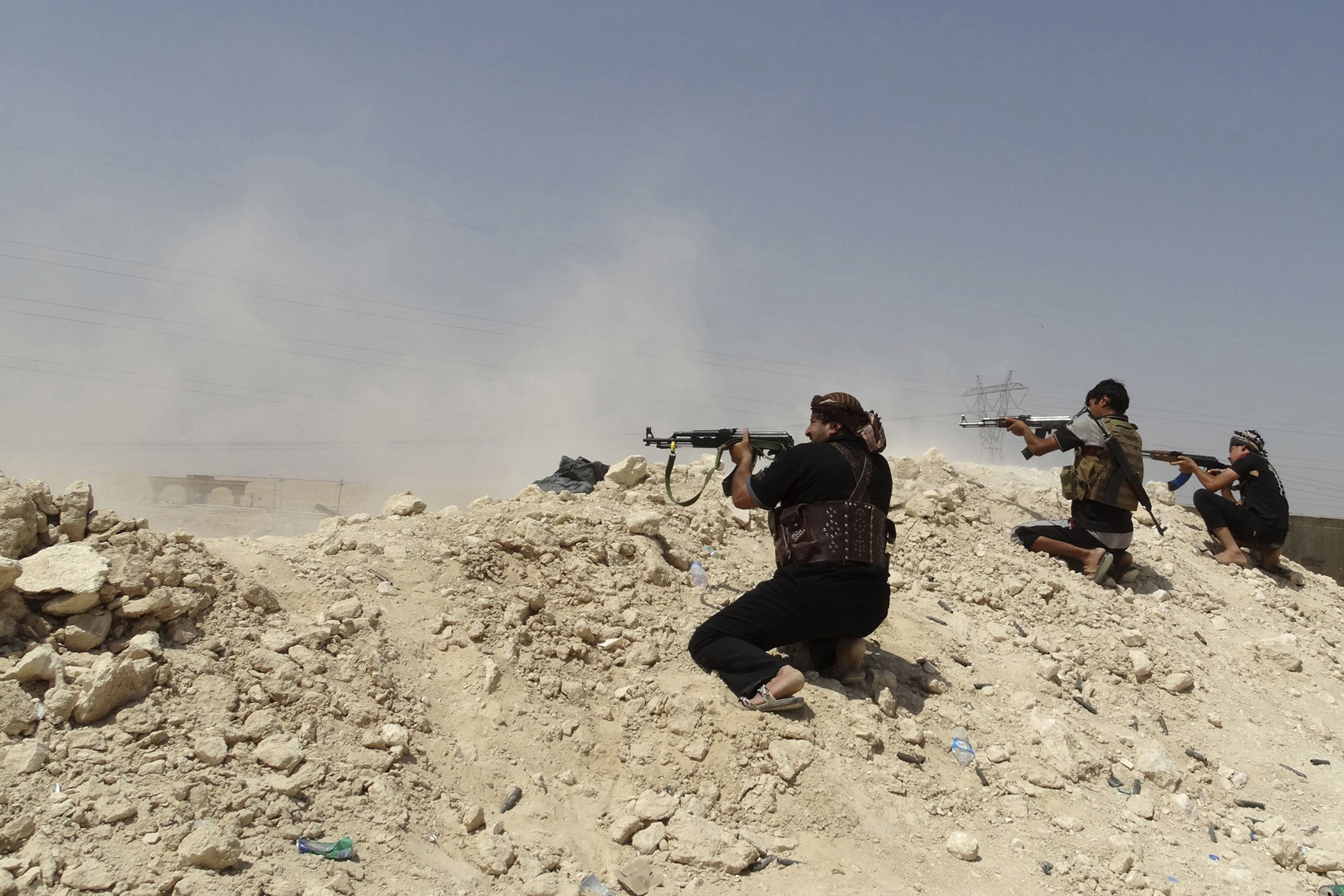 Tribal fighters seen during a battle with ISIS militants, in Haditha, Iraq, Aug. 25, 2014.