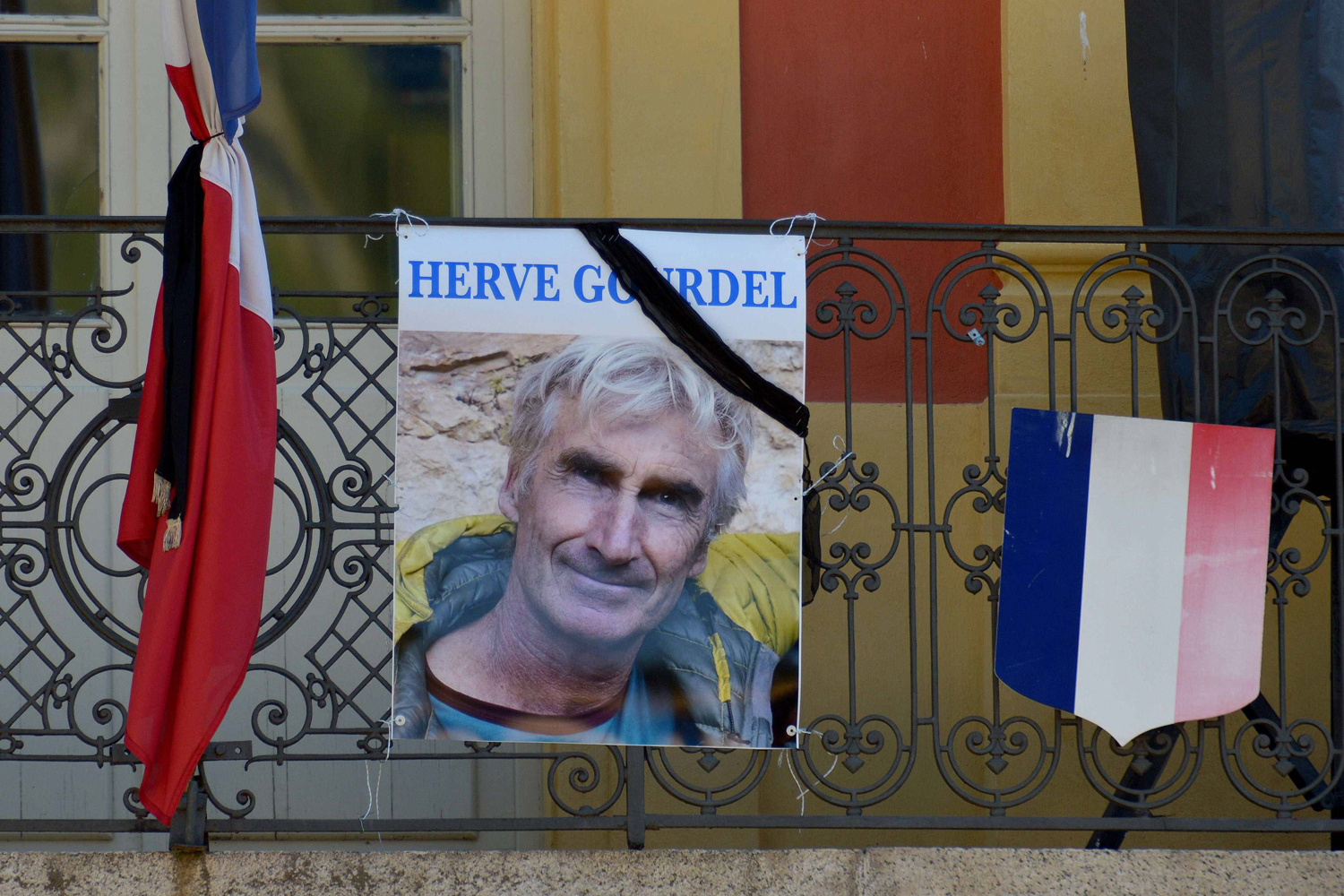 A portrait of Herve Gourdel hangs outside the town hall in Saint-Martin-Vesubie, France, Sept. 25, 2014.
