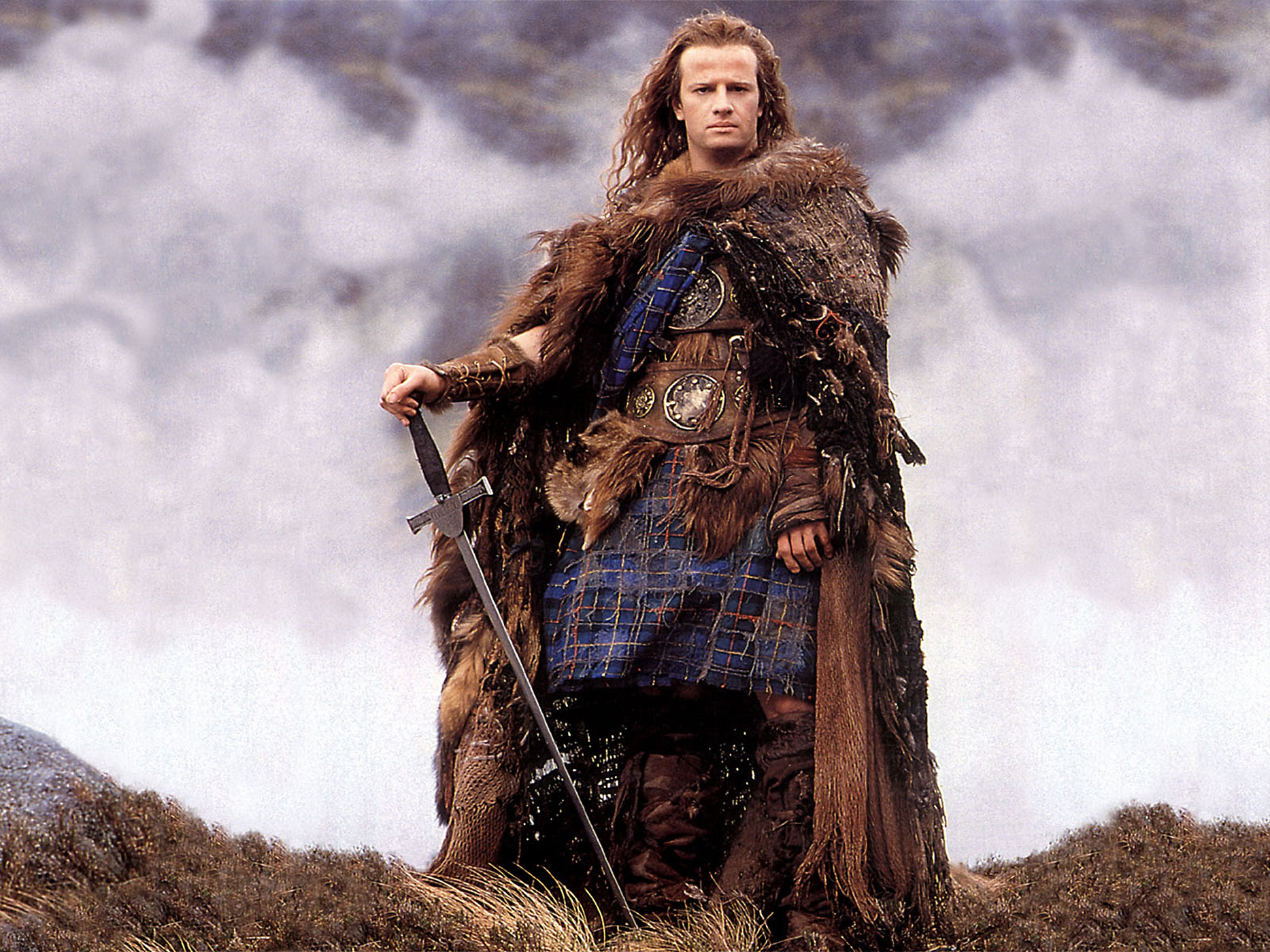 "Highlander, 1986. ""There can be only one."" Shuttling between the 16th-century Scotland and 20th-century New York City, this cult fantasy imagines a meeting of warrior ""immortals."" To defeat the evil Kurgan (Ohio's Clancy Brown), the heroic Scotsman Connor MacLeod (Christopher Lambert, an American raised in French-speaking Geneva) must imbibe the wisdom of his mentor Juan Sànchez Villa-Lobos Ramirez (played by — Sean Connery!) Directed by music-video king Russell Mulcahy, with songs by Queen."