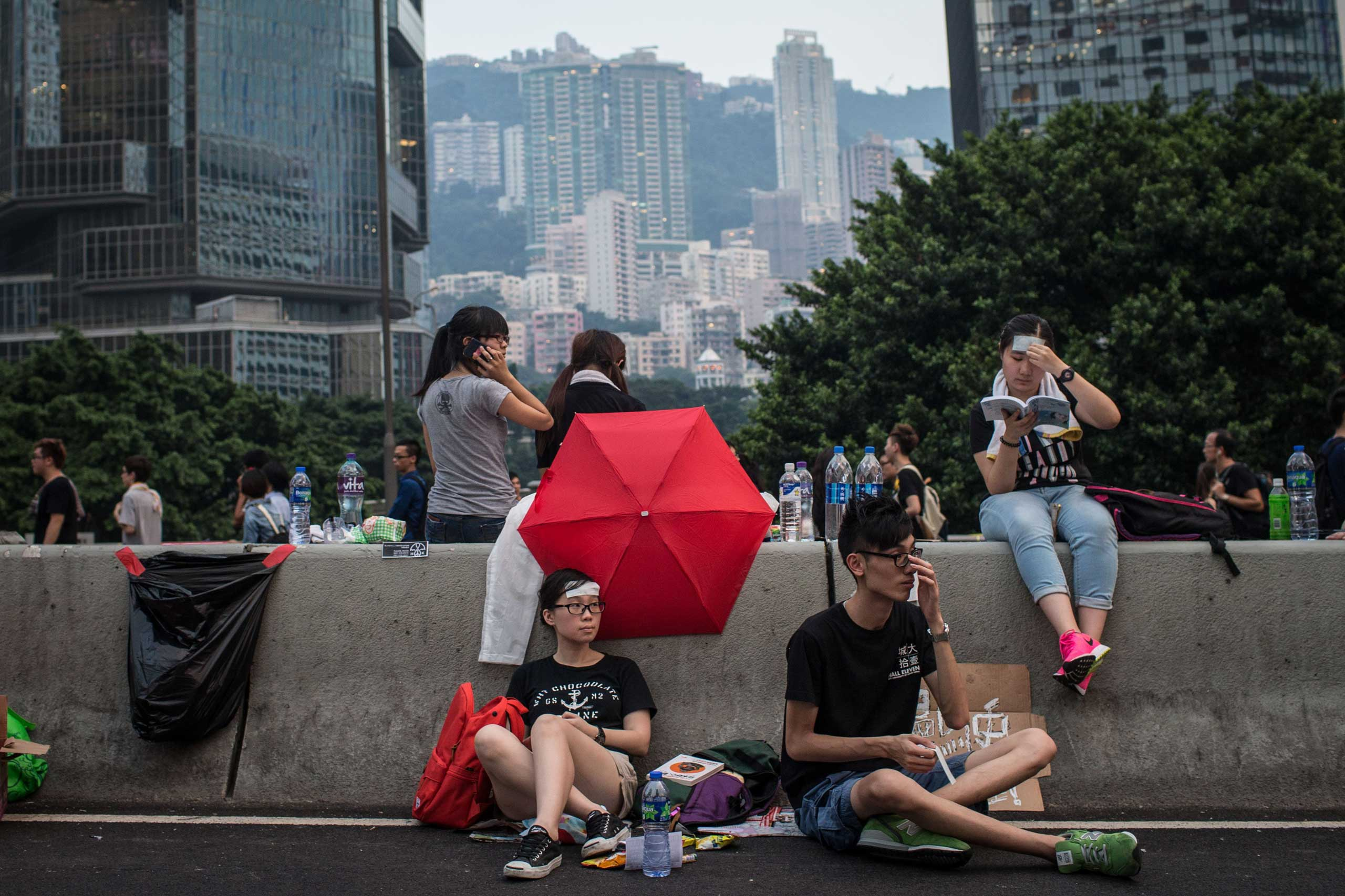 Protesters relax on the streets outside the Hong Kong Government Complex on Sept. 30, 2014 in Hong Kong, Hong Kong.