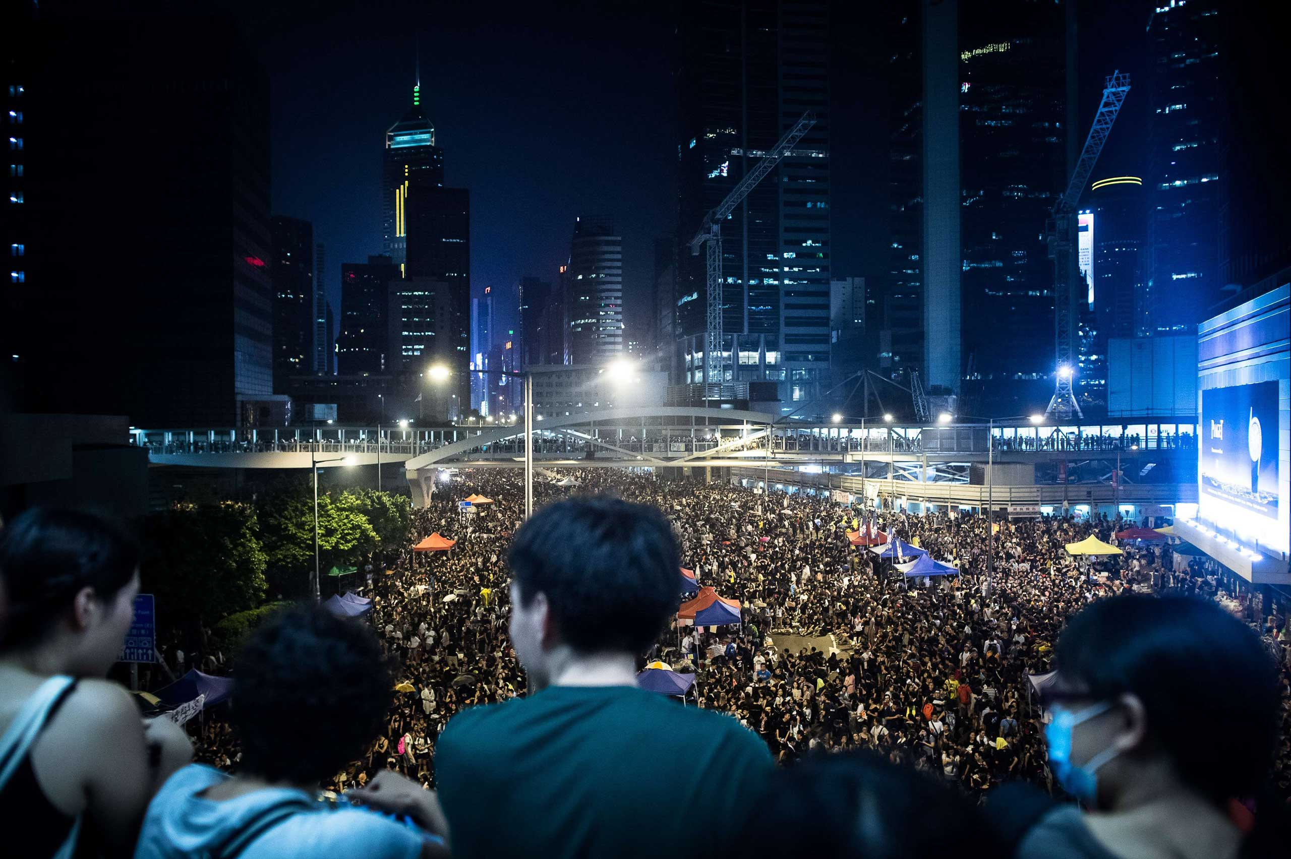 Pro-democracy demonstrators gather for the third night in Hong Kong on Sept. 30, 2014.